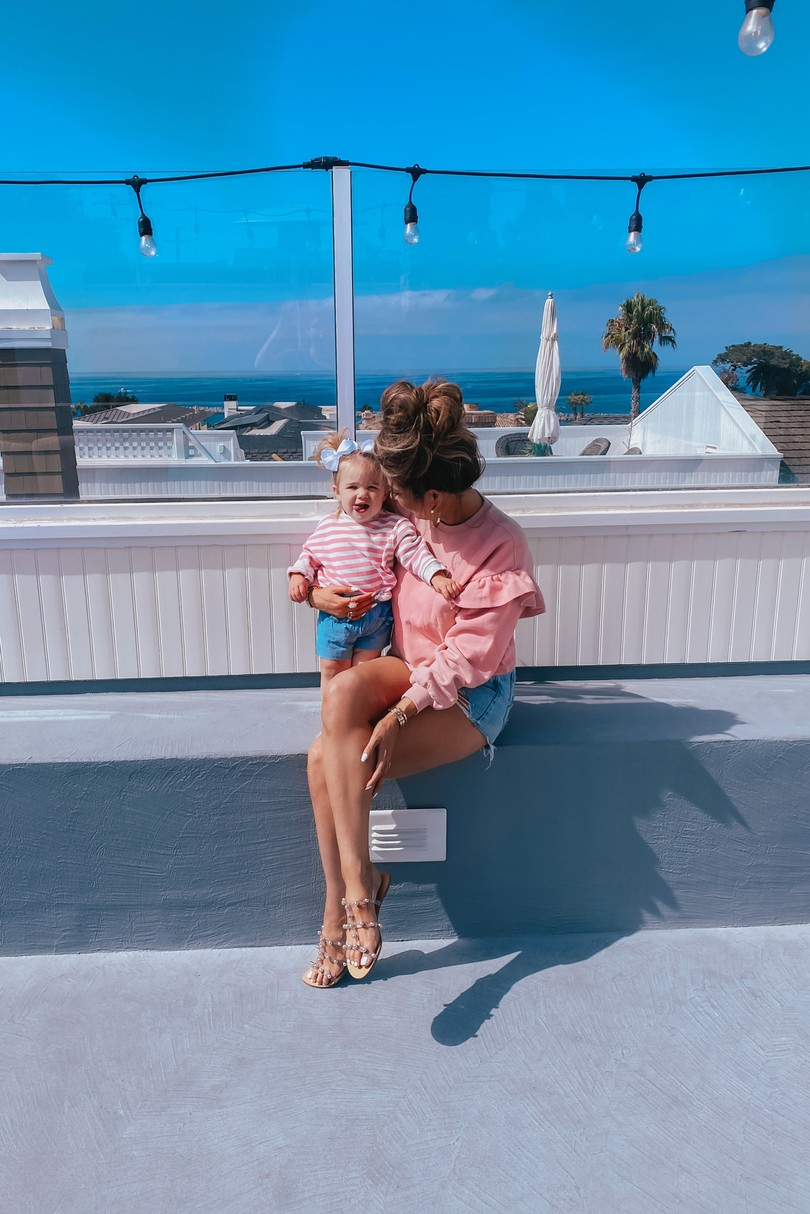 Instagram Recap by popular US lifestyle blog, The Sweetest Thing: image of Emily Gemma wearing a pink ruffle sleeve H&M sweatshirt, Schutz sandals, and BlankNYC jean shorts.
