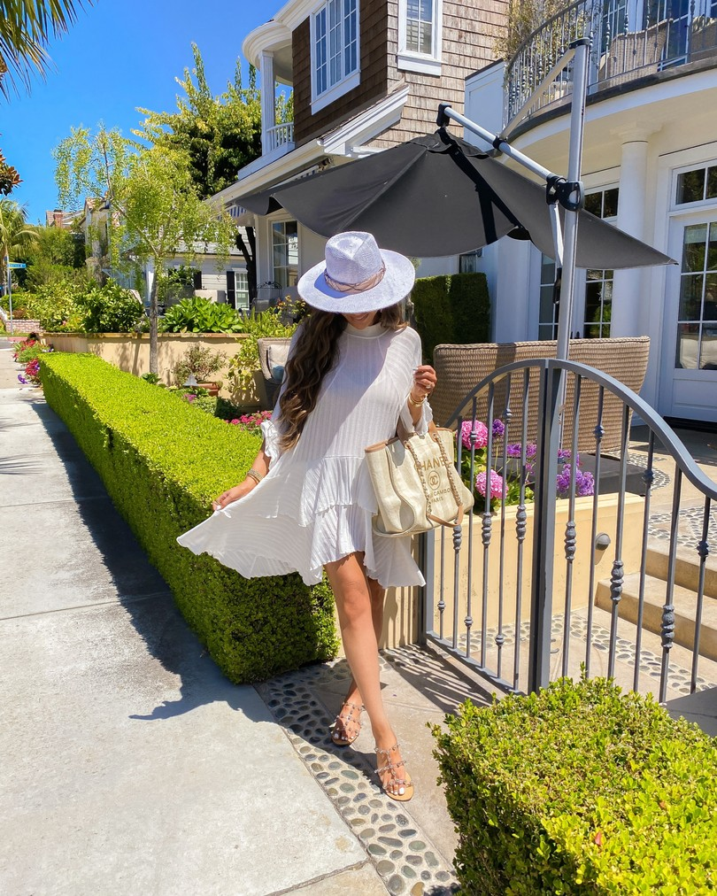 Instagram Recap by popular US lifestyle blog, The Sweetest Thing: image of Emily Gemma wearing a white Free People dress, Schutz sandals, Chanel bag, and ale by alessandra hat.