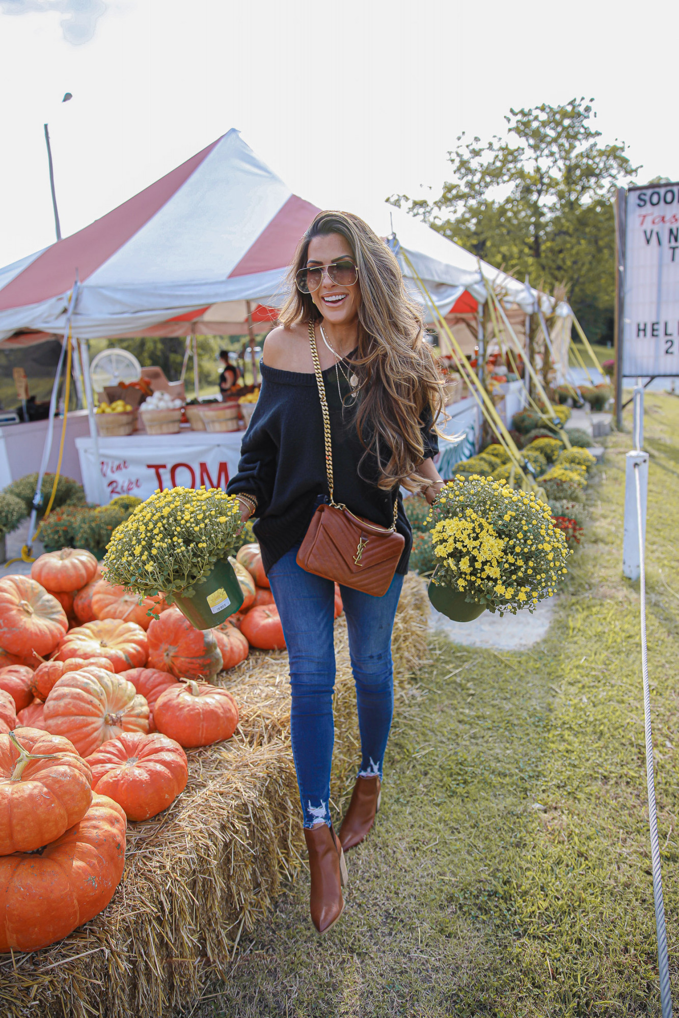 fall fashion 2020 pumpkin patch mums, free people fall fashion 2020 nordstrom, emily anng gemma |Instagram Recap by popular US lifestyle blog, The Sweetest Thing: image of Emily Gemma wearing a Free People black sweater, Good American Jeans, YSL bag, 8 other reasons necklace, Bon Levy earrings, brown Steve Madden ankle boots, and Alexander McQueen sunglasses while standing next to a pile of pumpkins and potted mums.