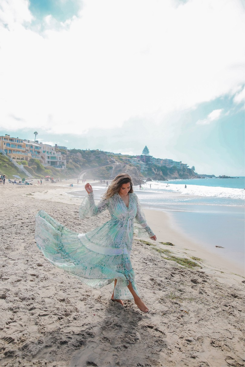 Instagram Recap by popular US lifestyle blog, The Sweetest Thing: image of Emily Gemma wearing a Free People dress and walking in the sand next to the ocean.