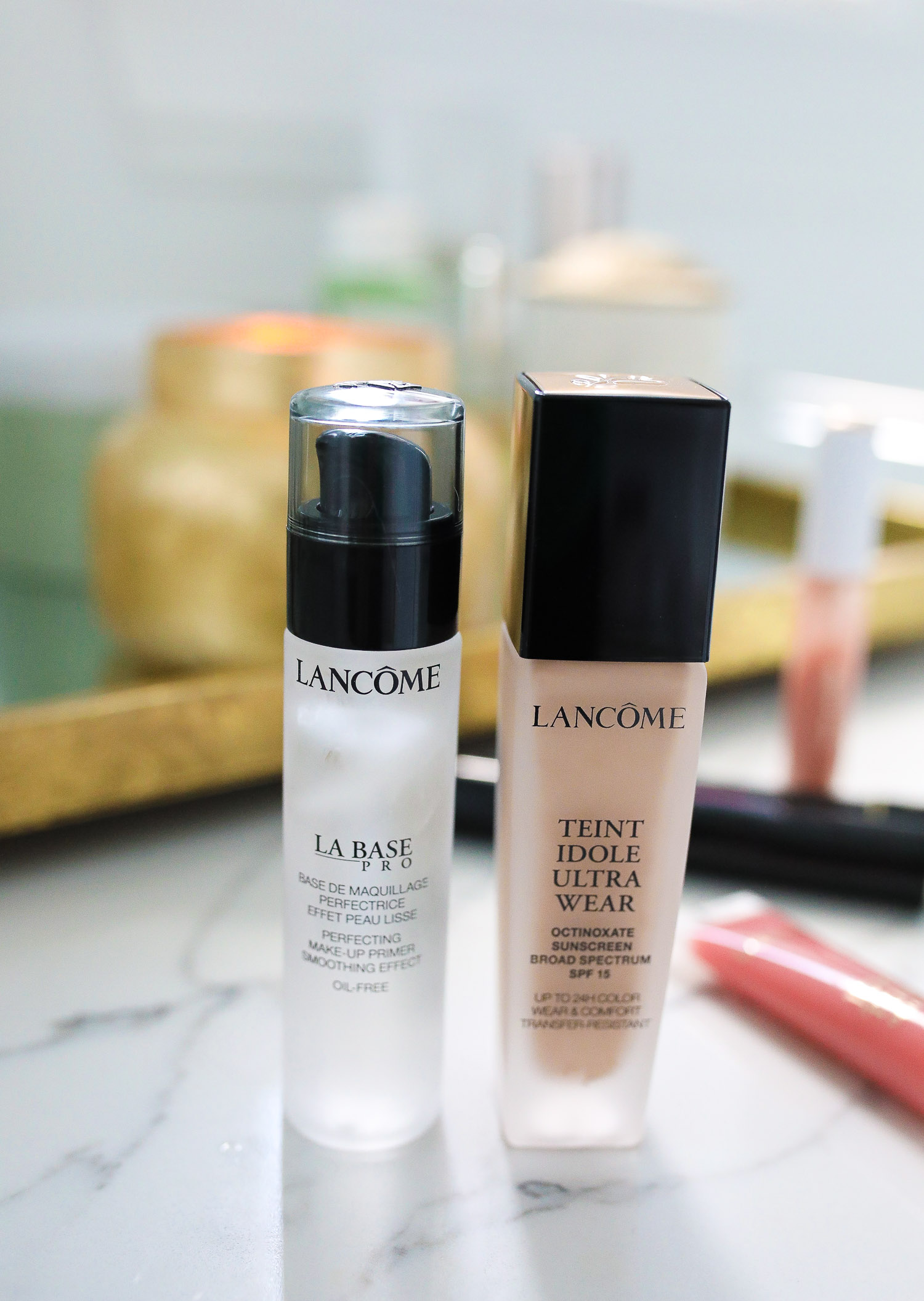 Lancôme Teint Idole Ultra Wear by popular US beauty blog, The Sweetest Thing: image of a bottle of Lancome Teint Idole Ultra Wear foundation next to a bottle of Lancome La Base pro.