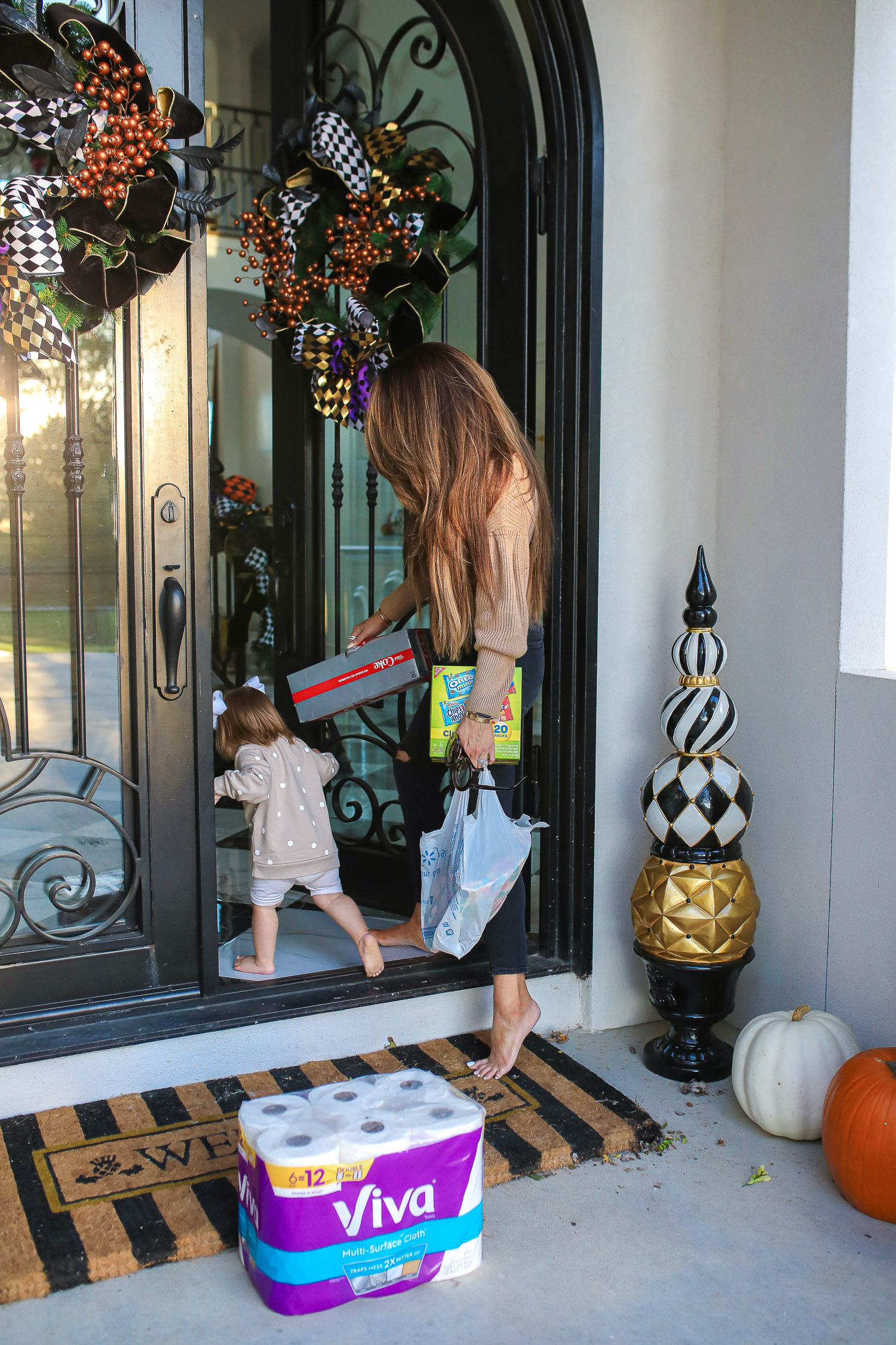 walmart online pickup and delivery review, easiest way to order groceries online, walmart online grocery order, emily ann gemma | Walmart Grocery Pickup Faq by top US lifestyle blog, The Sweetest Thing: image of Emily Gemma and her daughter Sophie standing on their front porch next to a package of VIva toilet paper and a case of Diet Coke.