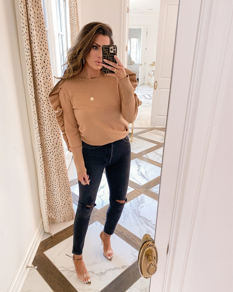 Instagram Recap by popular US lifestyle blog, The Sweetest Thing: image of Emily Gemma wearing a tan ruffle sleeve sweater, black Agolde jeans, Styled Collection earrings, and Gianvito Rossi heeled sandals.