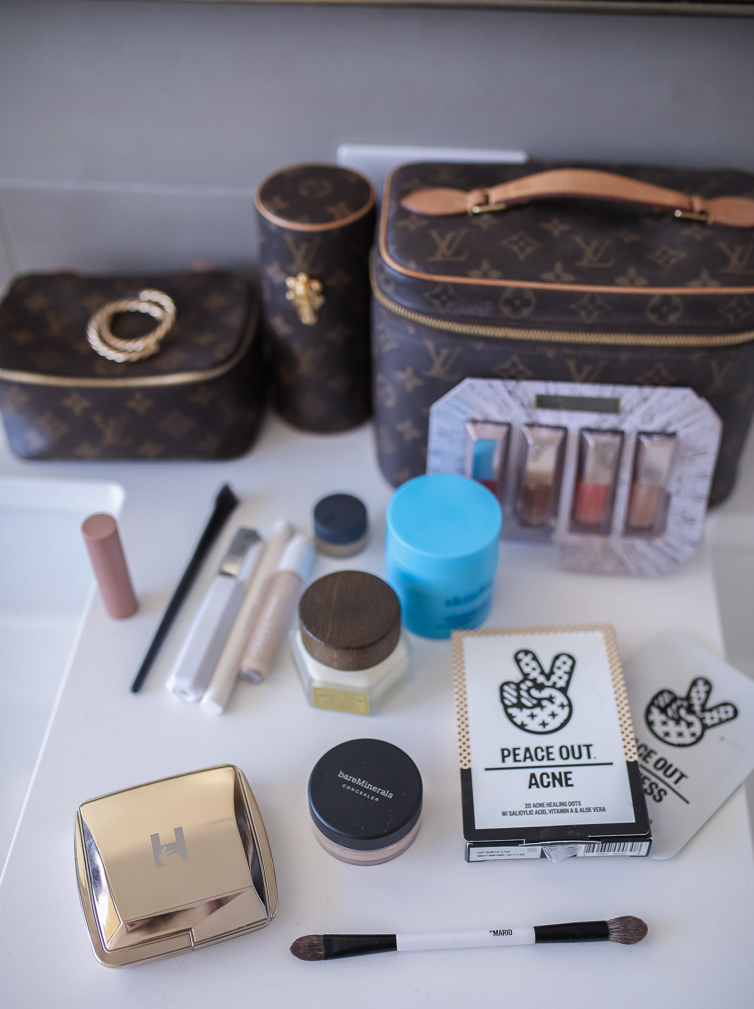 Sephora savings event fall 2020, sephora VIB sale event, beauty blogger sephora favorites fall 2020, emily ann gemma-10 |Sephora Beauty Insider Sale by popular US beauty blog, The Sweetest Thing: image of Louis Vuitton makeup and jewelry cases next to Sephroa beauty products.