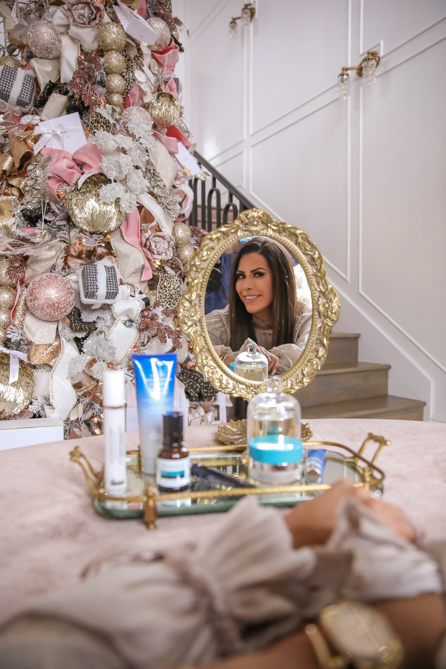 Dr Brandt review eye baggage, best dr brandt products, Dr Brandt Pores No More, Emily Gemma |Dr. Brandt by popular US beauty blog, The Sweetest Thing: image of Emily Gemma looking at her self in a Anthropologie hand mirror.