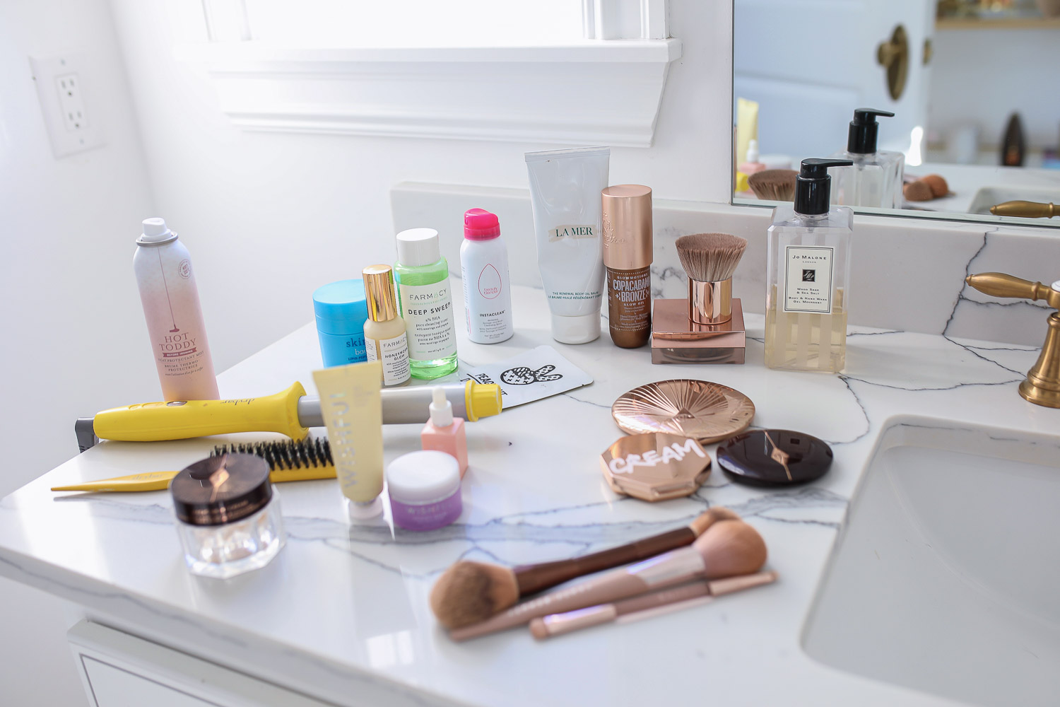 Sephora savings event fall 2020, beauty blogger sephora favorites fall 2020, emily ann gemma |Sephora Beauty Insider Sale by popular US beauty blog, The Sweetest Thing: image of Sephora beauty products products on a bathroom vanity counter.