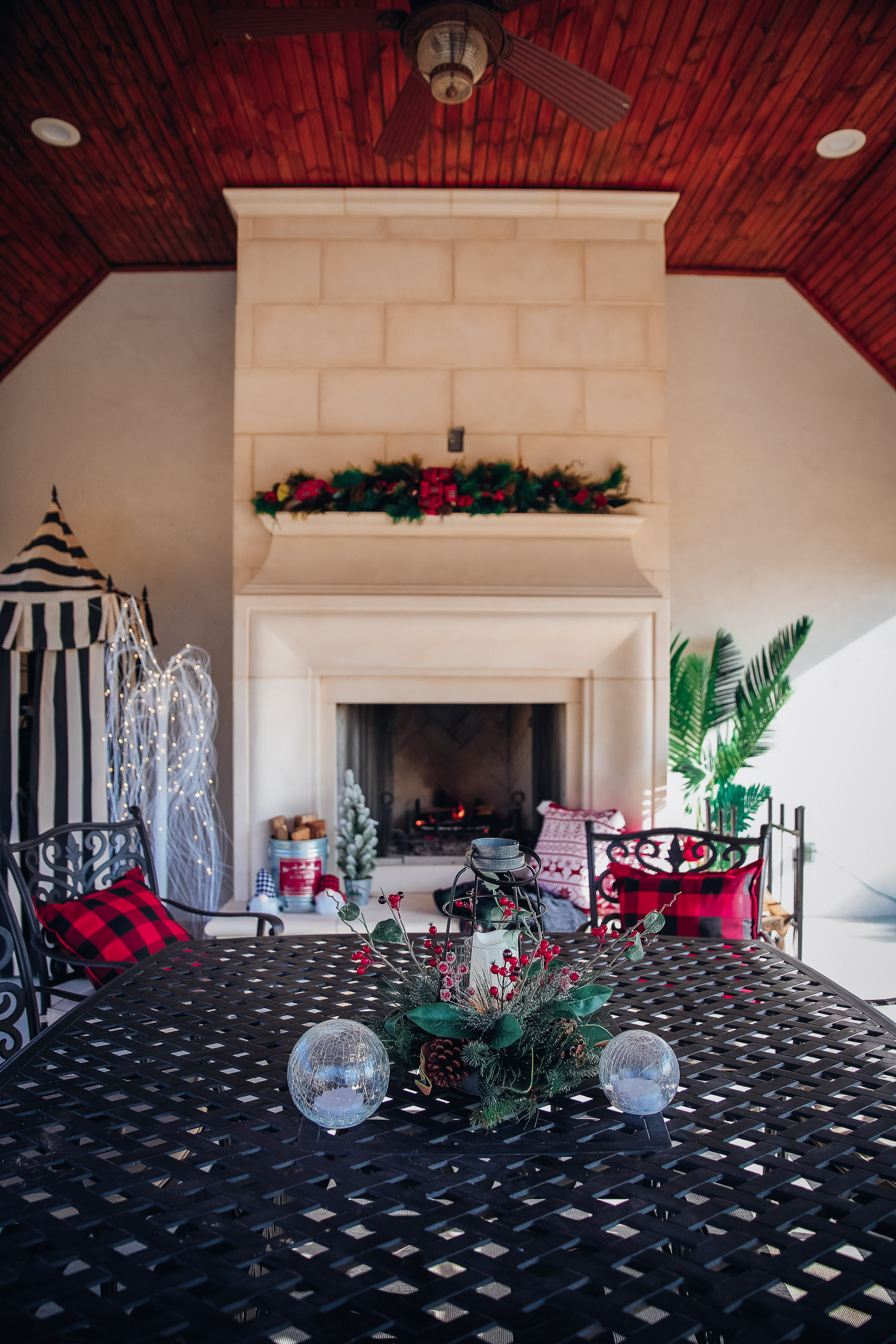 backyard decor christmas, outdoor pool christmas decor, walmart pool ornament, emily gemma backyard |Christmas Pool Decorations by popular US life and style blog, The Sweetest Thing: image of a pool house decorated with Christmas garland, black and red buffalo check throw pillows, Christmas tree decor, and candles.