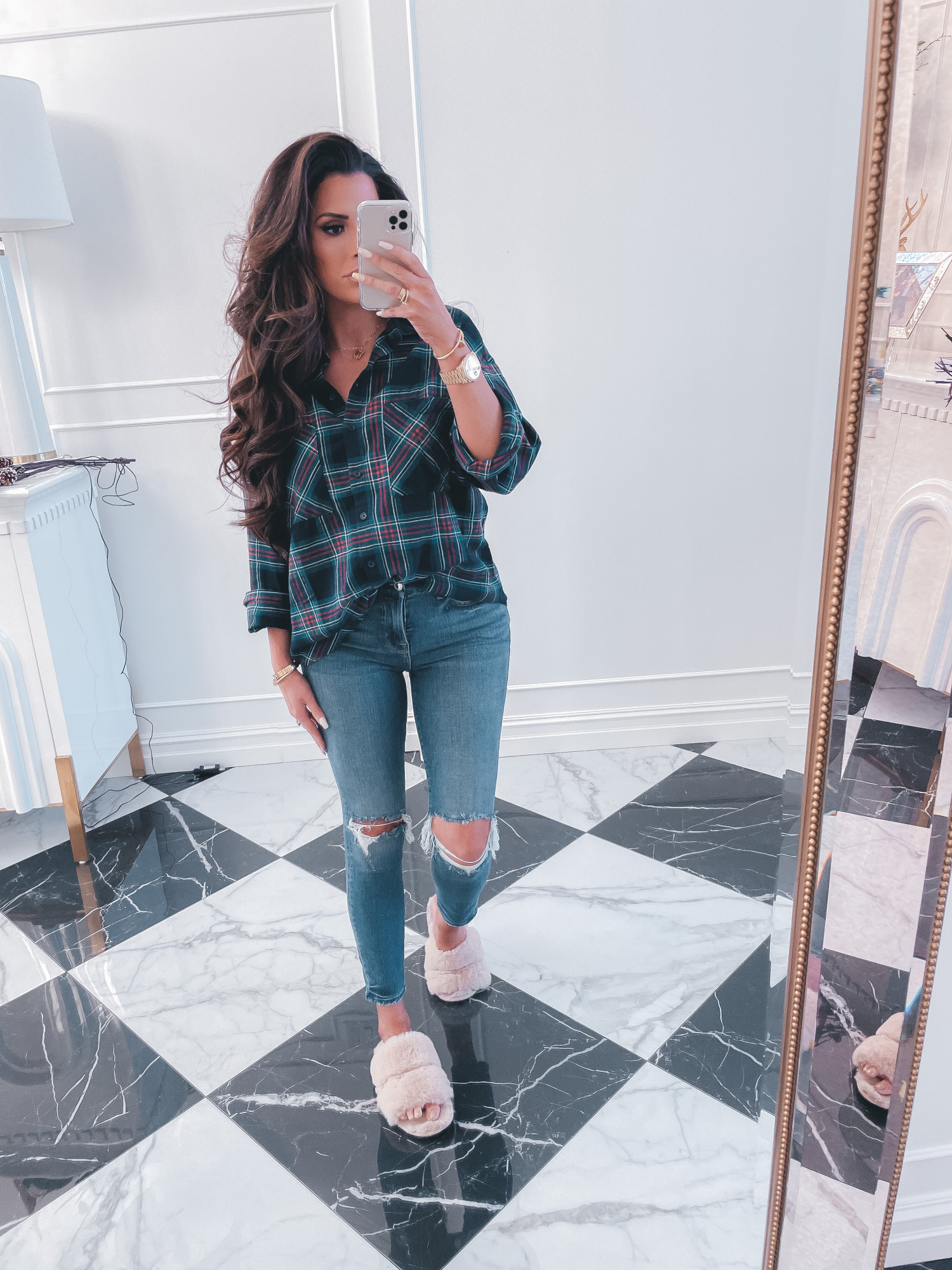 best black friday cyber monday sales 2020, top black friday sales 2020, emily gemma1 |2020 Black Friday Deals by popular US life and style blog, The Sweetest Thing: image of Emily Gemma wearing a plaid button up shirt, distressed denim, and fuzzy pink sandal slippers.