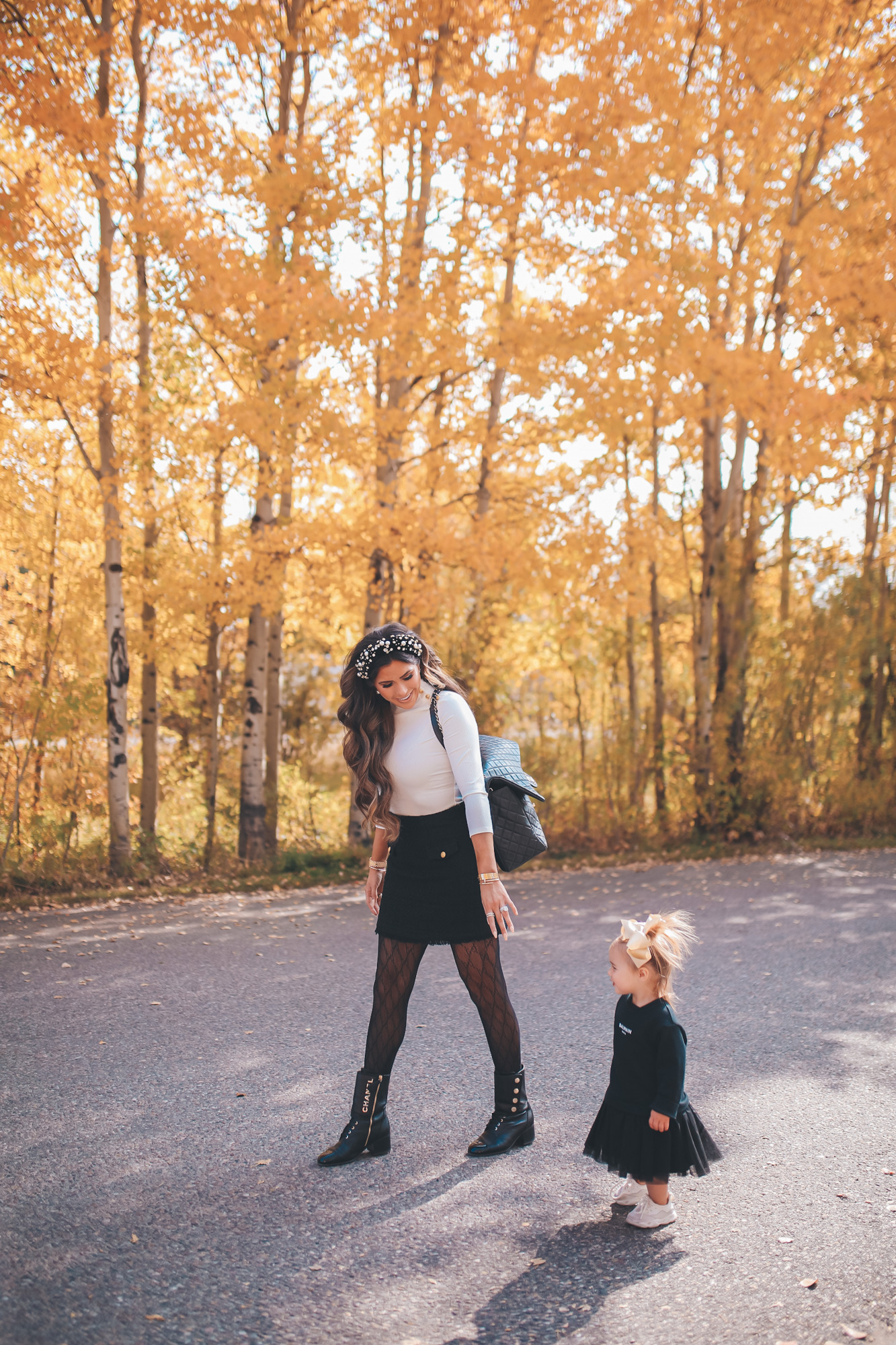 fall fashion pinterest outfits 2020, chanel combat boots black, tweed skirt with gucci tights, emily gemma, JPG |fall fashion pinterest outfits 2020, express fall fashion, emily gemma, baby girl fall outfits | Fall Clothing by popular US fashion blog, The Sweetest Thing: image of Emily Gemma walking outside with her young daughter and wearing a Express Novelty Button Mock Neck Top, Express High Waisted A-Line Tweed Mini Skirt, Chanel boots, Gucci tights, Cartier bracelet and pearl knot headband.