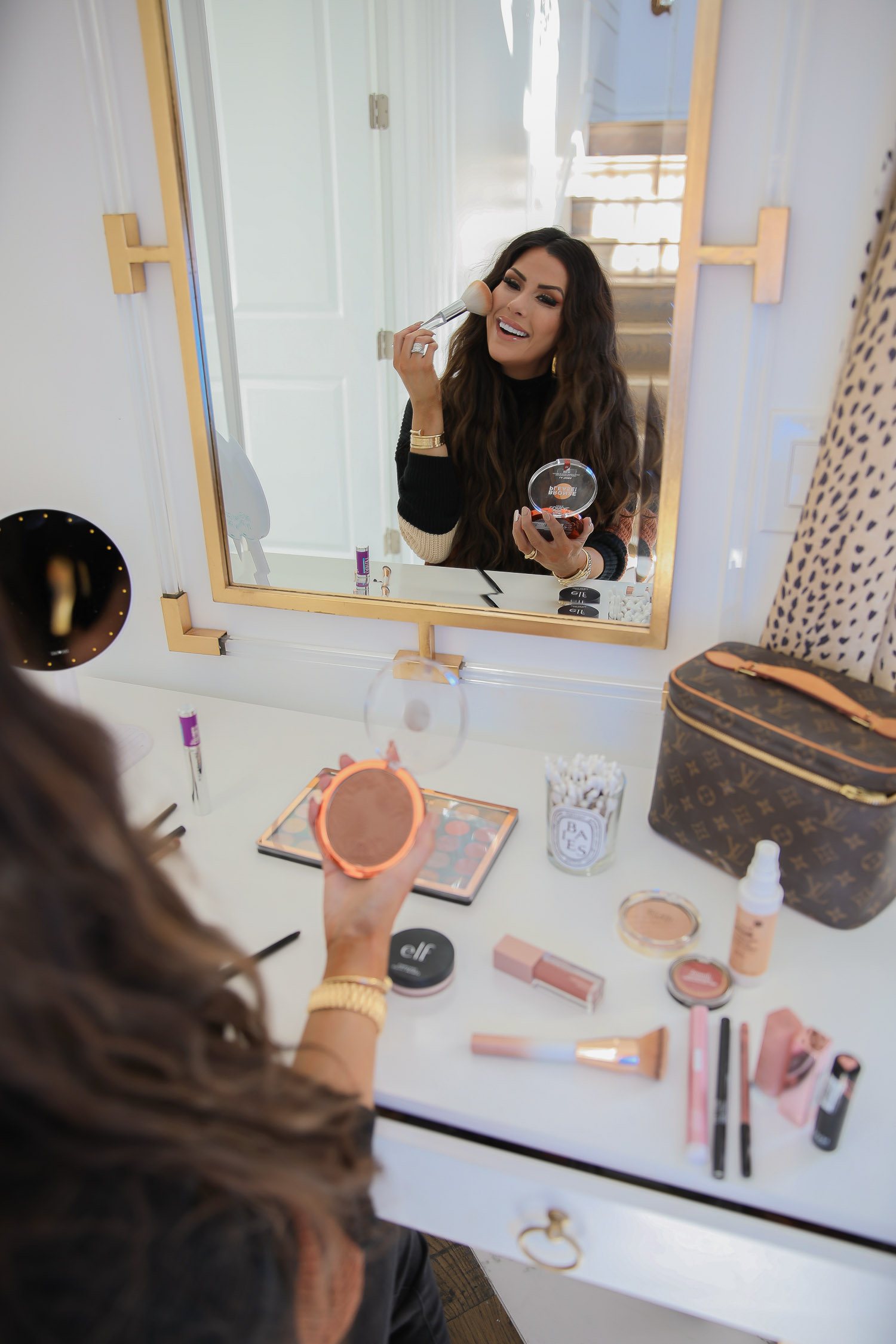 walmart beauty blog post, best drugstore makeup fall 2020, leopard print qtips, Mirage revolution palette review, best drugstore makeup brushes |November Instagram Recap by popular US lifestyle blog, The Sweetest Thing: image of Emily Gemma wearing a Red Dress black and tan stripe sweater and looking at herself in her vanity mirror while applying bronzer.