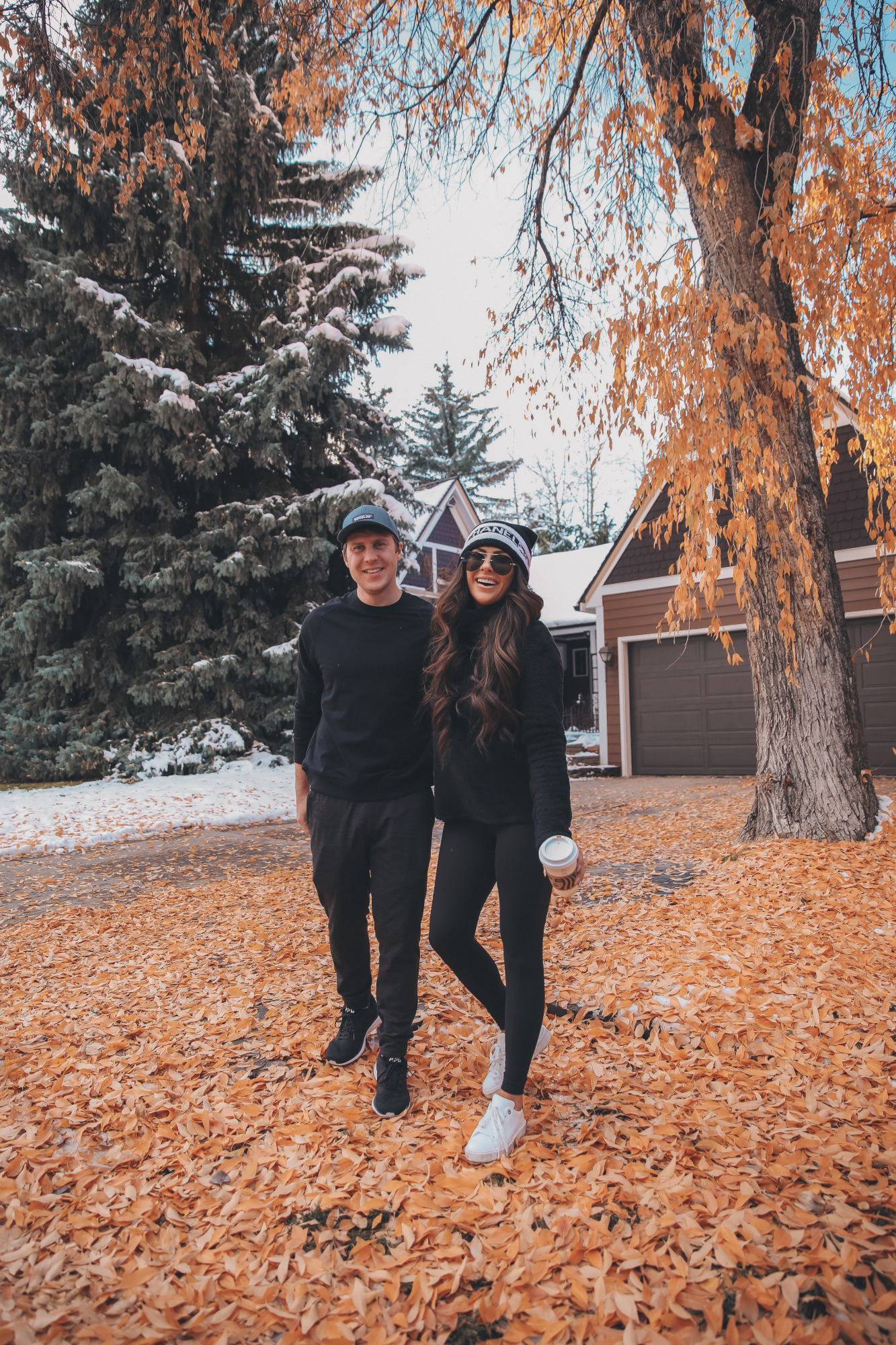 zella nordstrom review, emily gemma, le spec aviators, chanel beanie 2020 | Athleisure Wear by popular US fashion blog, The Sweetest Thing: image of a husband wearing a Logo Baseball Cap PATAGONIA, Pyrite Slim Fit Joggers ZELLA, and Crewneck Fleece Sweatshirt ZELLA, and a wife wearing a Furry Fleece Funnel Neck Pullover ZELLA, Booty Boost Active 7/8 Leggings SPANX,Charlie Platform Sneaker STEVE MADDEN,Panarea 60mm Aviator Sunglasses LE SPECS, and Lip Cheat Lip Liner CHARLOTTE TILBURY and standing together outside on a leaf covered driveway.