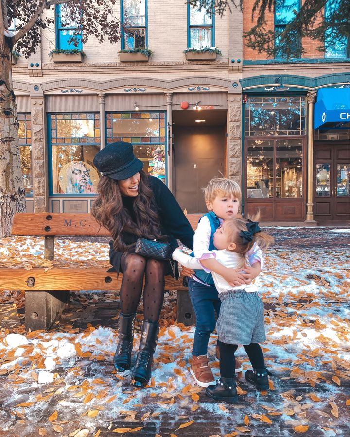 November Instagram Recap by popular US lifestyle blog, The Sweetest Thing: image of Emily Gemma sitting outside on a bench with her son and daughter and wearing a Chanel dress, Chanel cap, Chanel ankle boots, Chanel tights, and Chanel black quilted purse.
