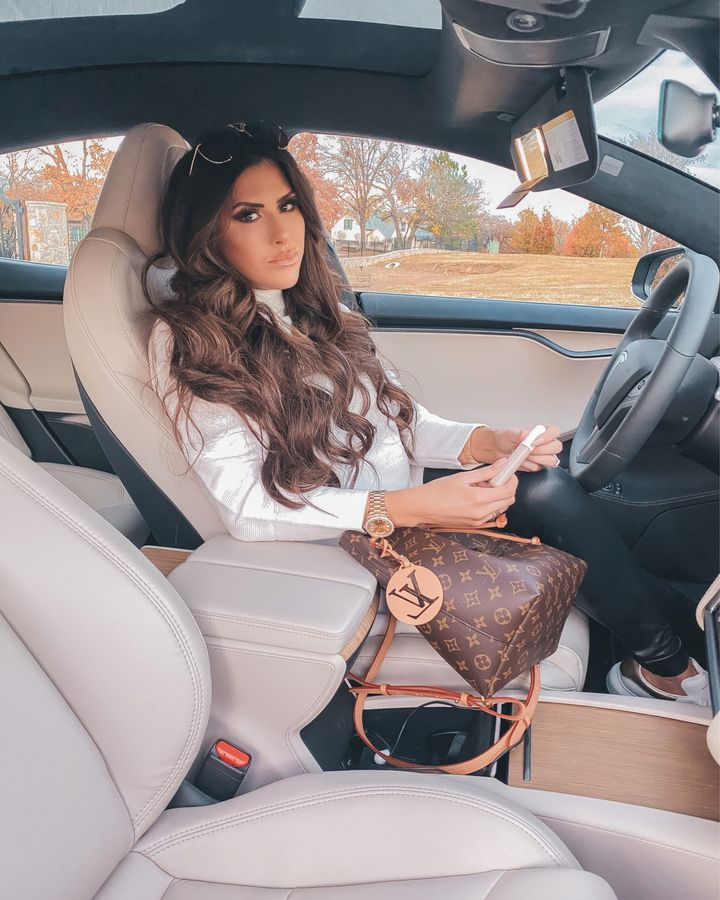 November Instagram Recap by popular US lifestyle blog, The Sweetest Thing: image of Emily Gemma sitting in her car and wearing a Amazon long sleeve white shimmer top, black faux leather leggings, and sitting next to her Louis Vuitton bag.