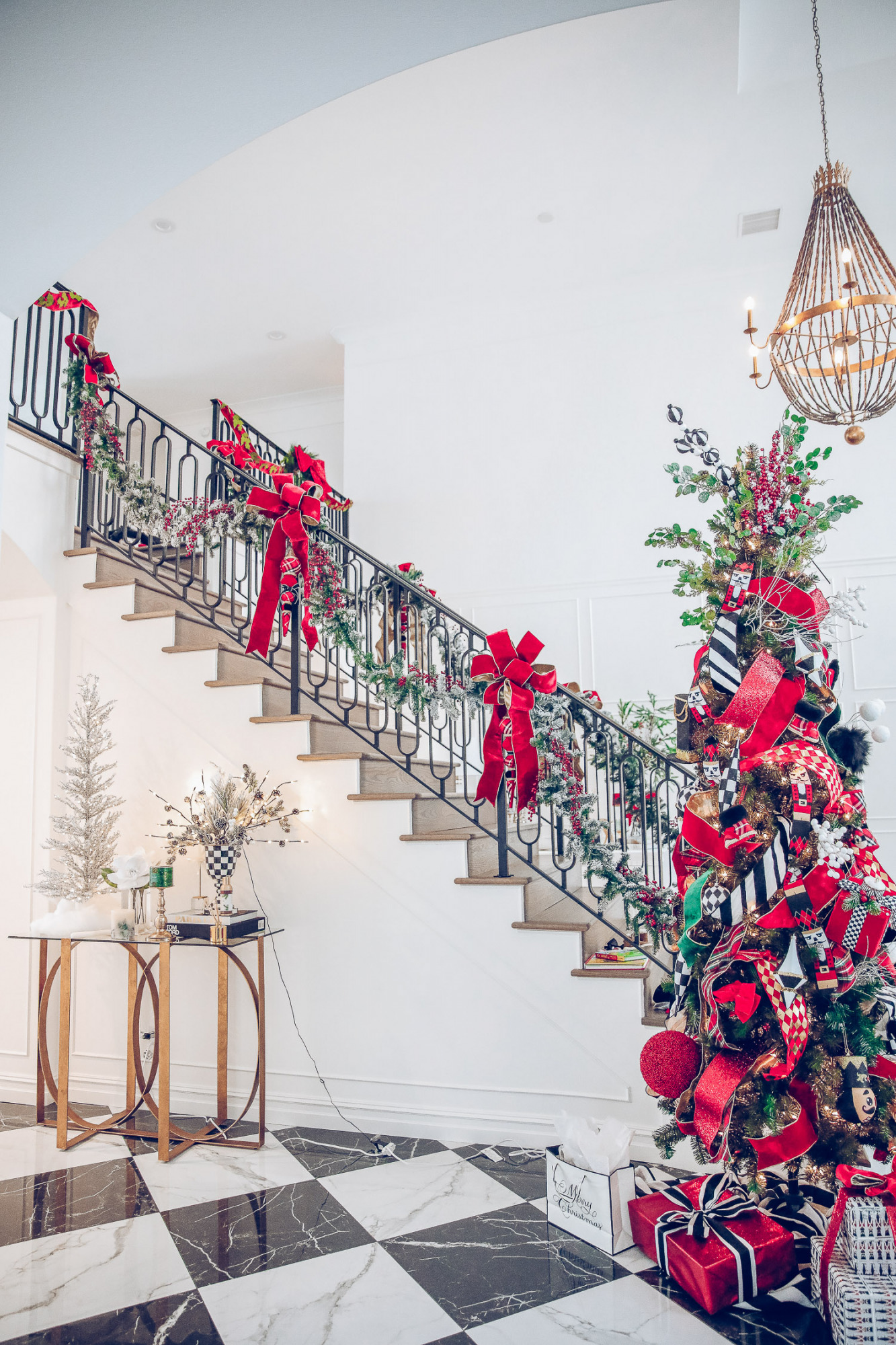 Christmas outdoor decorations home depot, emily gemma home, christmas wreaths on gates with bow, blow up nutcrackers, |Holiday Home Decor by popular US life and style blog, The Sweetest Thing: image of a entry way decorated with wreaths, holiday bows, faux garland, and a nutcracker Christmas tree.