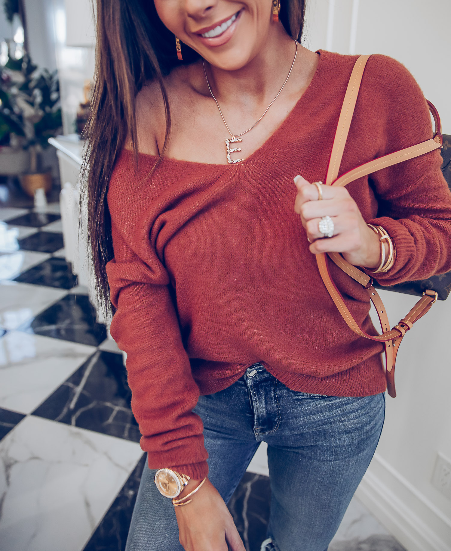 Nordstrom gift guide ideas 2020, nadri bracelets, louis vuitton montisouris PM, emily gemma-6 |Last Minute Gift Ideas by popular US life and style blog, The Sweetest Thing: image of Emily Gemma wearing a Leith sweater, nadri bracelets, louis vuitton montisouris PM, Good American jeans, Louis Vuitton earrings, and Ettika necklace.