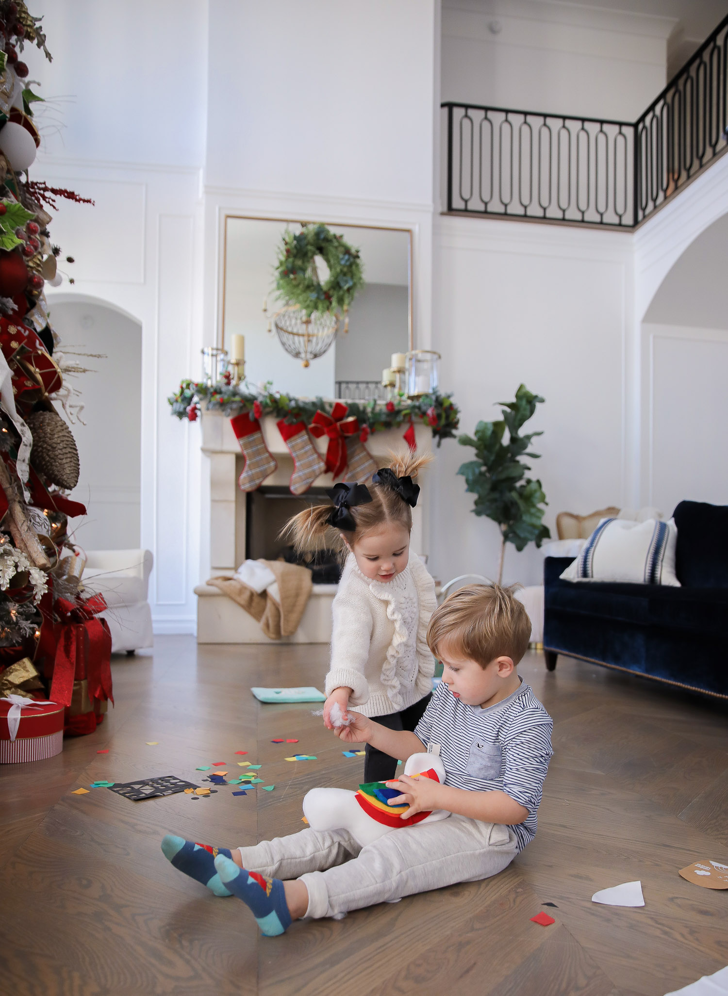 Educational Gift Ideas for Kids by popular US lifestyle blog, The Sweetest Thing: image of a boy and girl playing with KiwiCo toys.