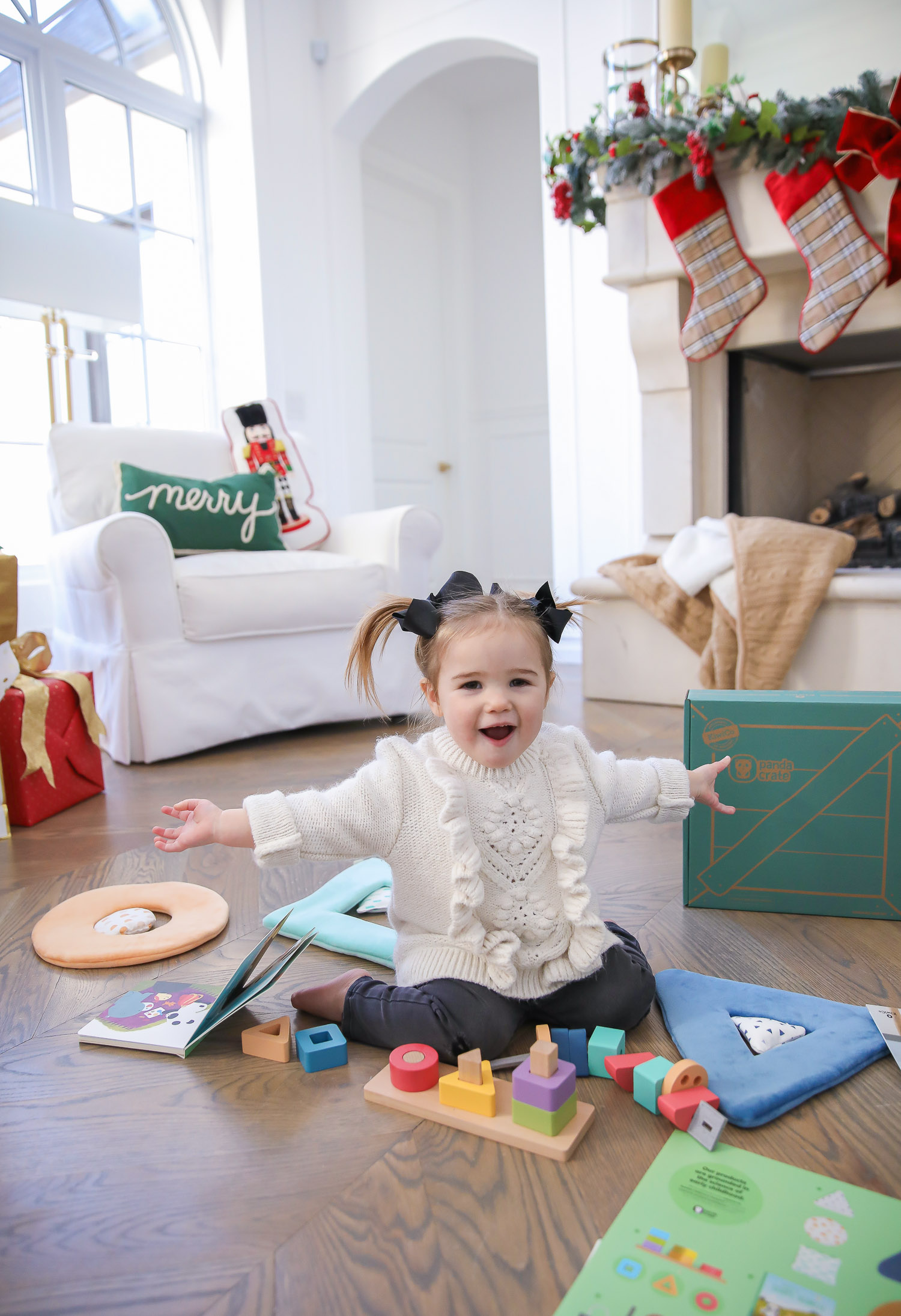 Educational Gift Ideas for Kids by popular US lifestyle blog, The Sweetest Thing: image of a girl playing with KiwiCo toys.