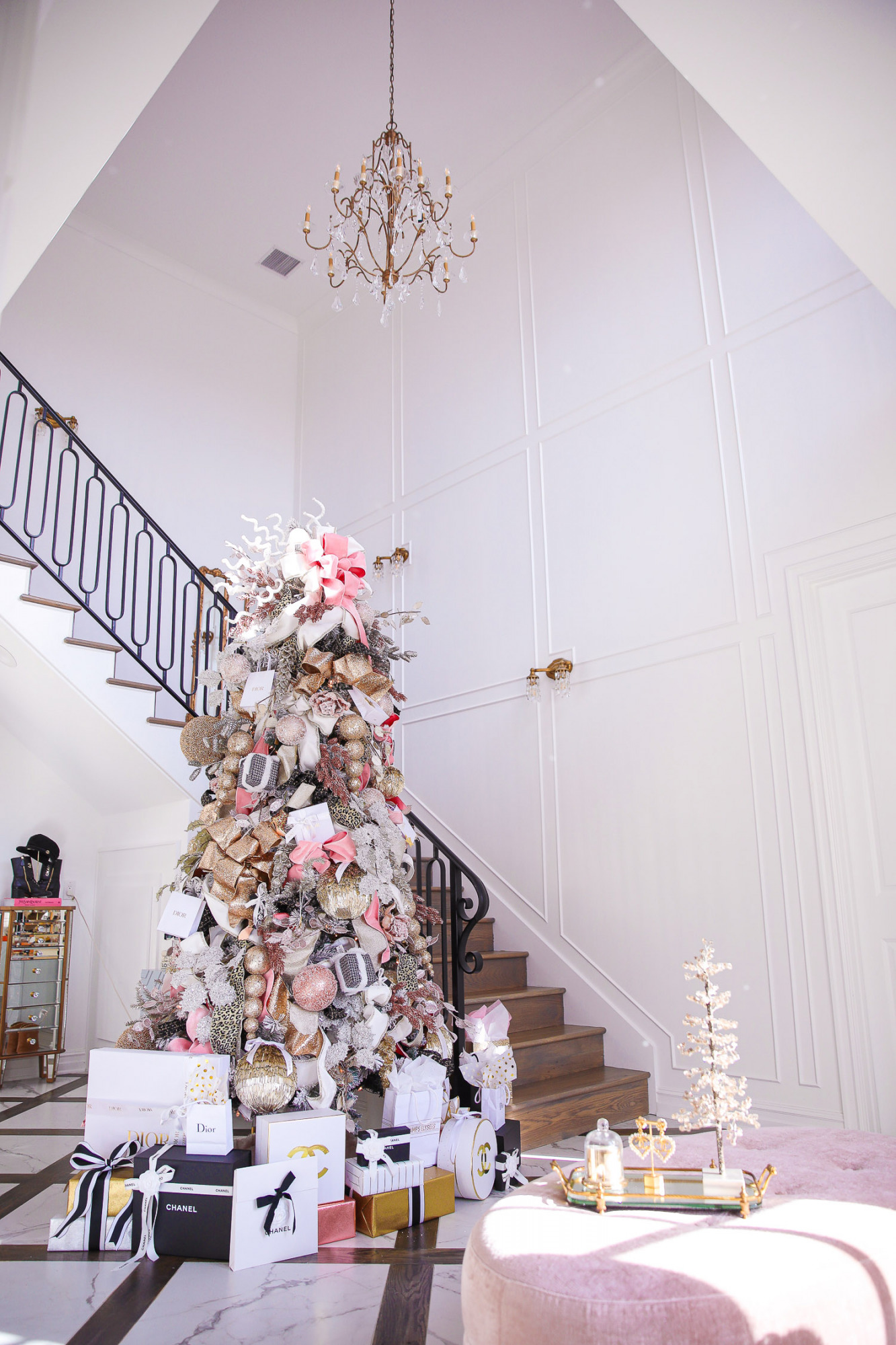 two story closet pinterest, designer chanel christmas tree, unique christmas trees, shop hello holidays, emily gemma christmas tree |Pink and Gold Christmas Tree by popular US life and style blog, The Sweetest Thing: image of a two story closet decorated with pink and gold Christmas Tree with high end retailer bags underneath.