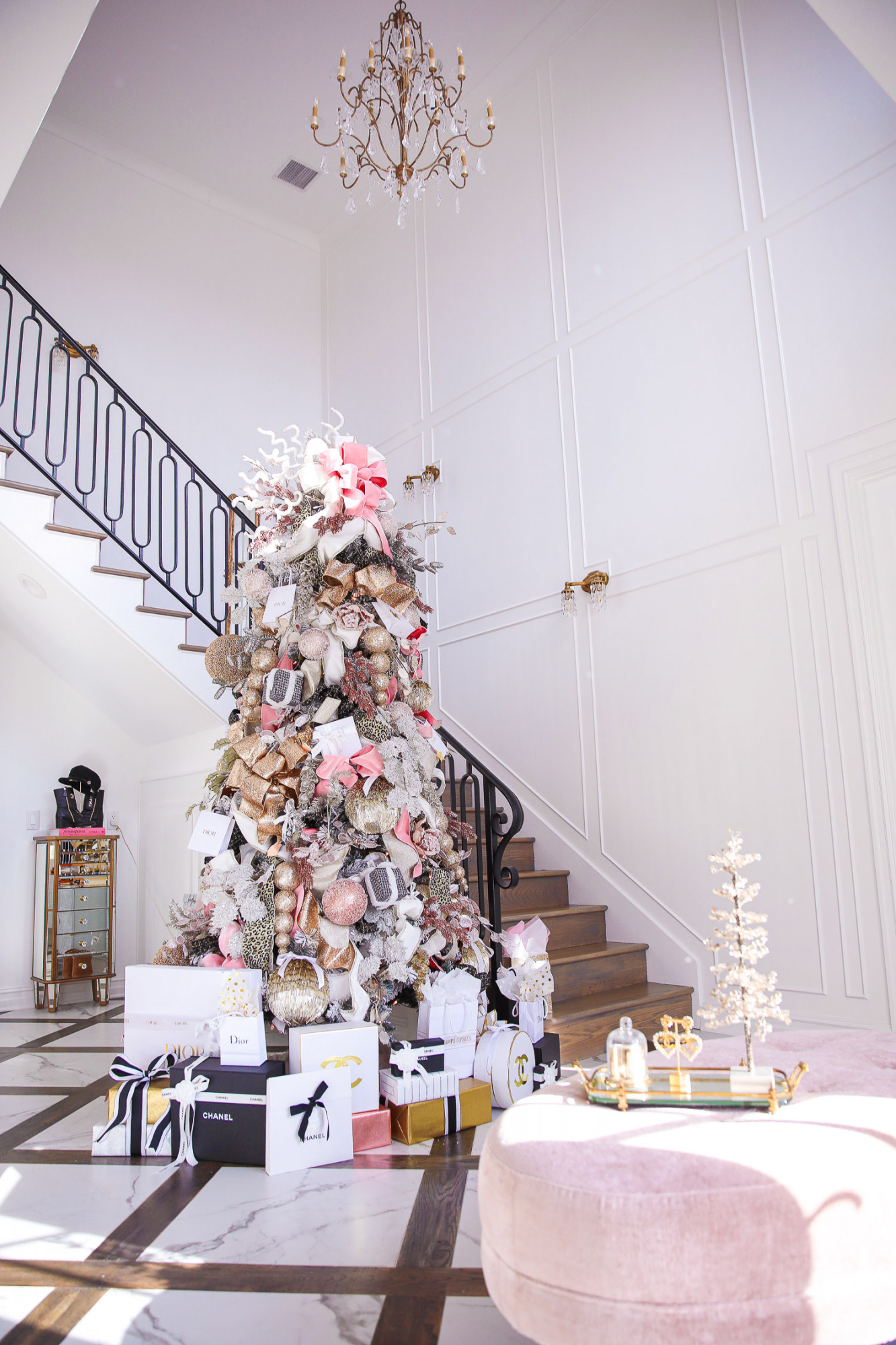 two story closet pinterest, designer chanel christmas tree, unique christmas trees, shop hello holidays, emily gemma christmas tree | Pink and Gold Christmas Tree by popular US life and style blog, The Sweetest Thing: image of a two story closet decorated with pink and gold Christmas Tree with high end retailer bags underneath.