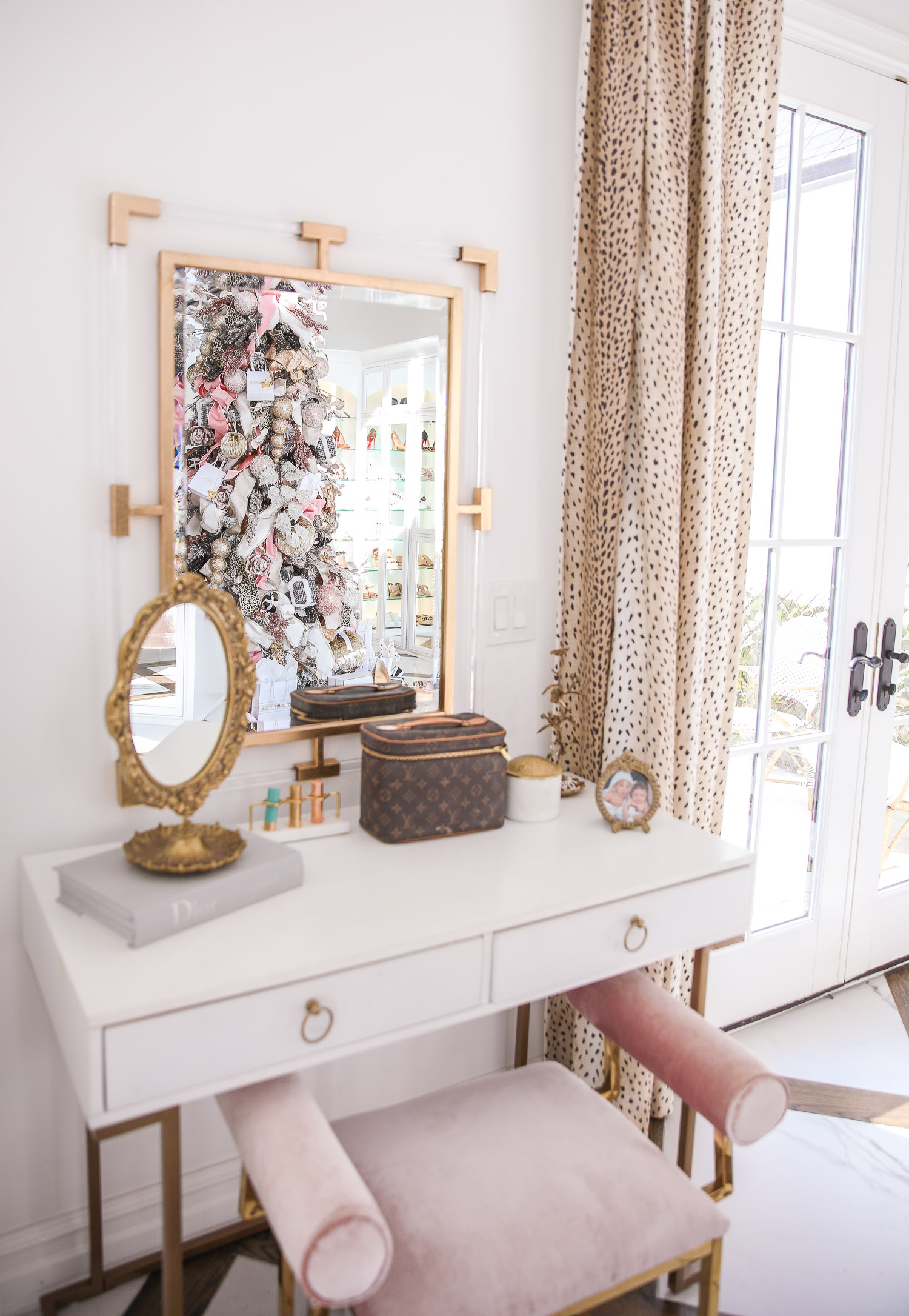 two story closet pinterest, designer chanel christmas tree, unique christmas trees, shop hello holidays, emily gemma christmas tree |Pink and Gold Christmas Tree by popular US life and style blog, The Sweetest Thing: image of a two story closet with floor length antelope print drapes and a white vanity with a pink velvet seat.