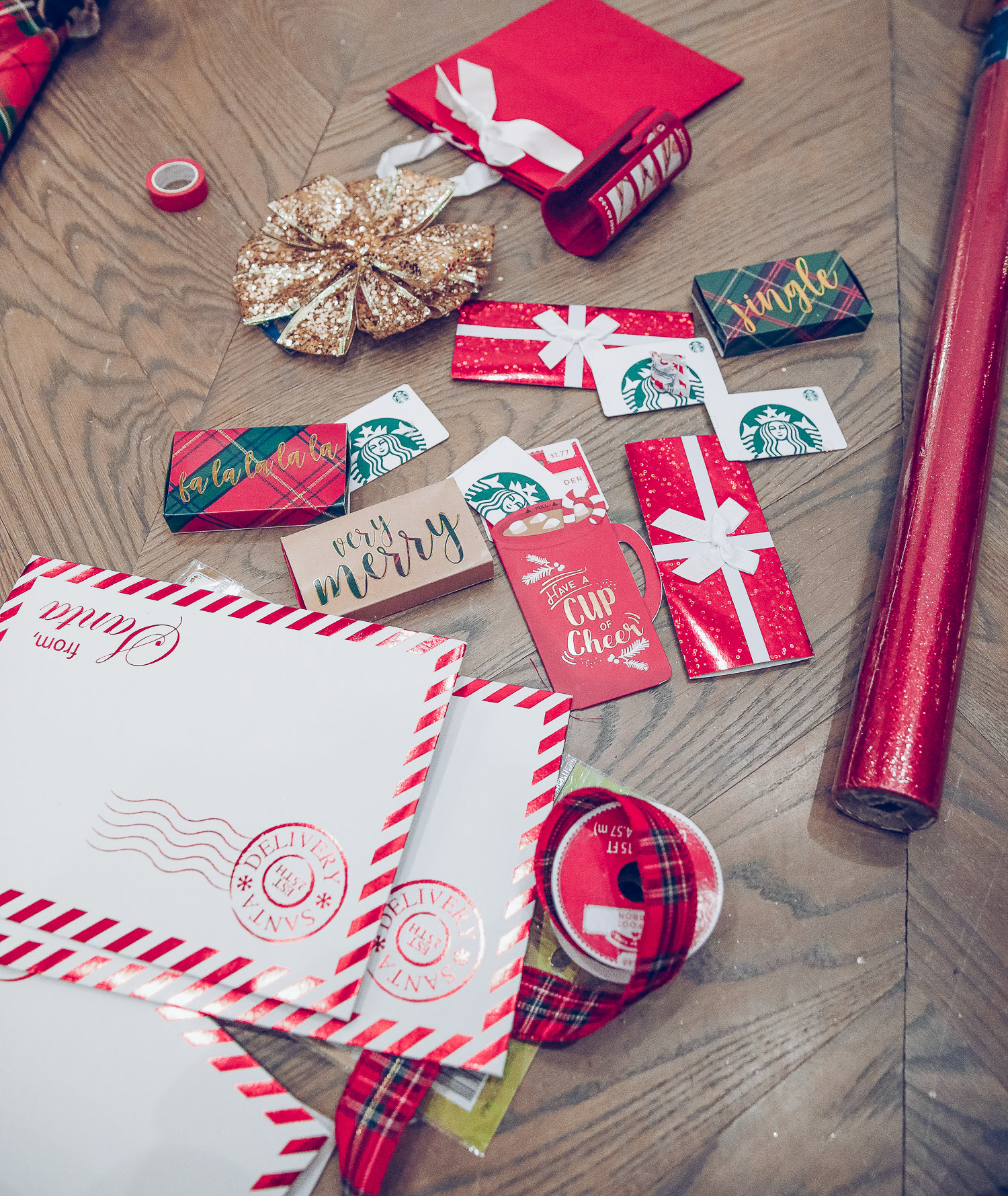 walmart gift wrap christmas 2020, shop hello holidays christmas tree, magnetic me PJs, emily ann gemma-10 |Gift Wrapping Ideas by popular US life and style blog, The Sweetest Thing: image of gift card envelops, red gift bag, gold gift bow, red wrapping paper and a plaid ribbon.