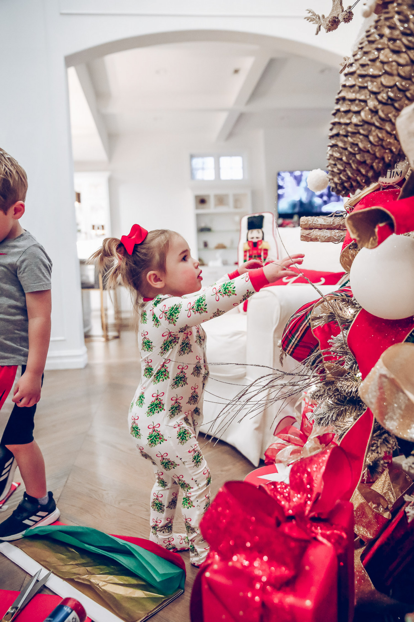 walmart gift wrap christmas 2020, shop hello holidays christmas tree, magnetic me PJs, emily ann gemma-10 |Gift Wrapping Ideas by popular US life and style blog, The Sweetest Thing: image of a little girl wearing Magnetic Me Christmas pjs while standing in front of her Christmas tree.
