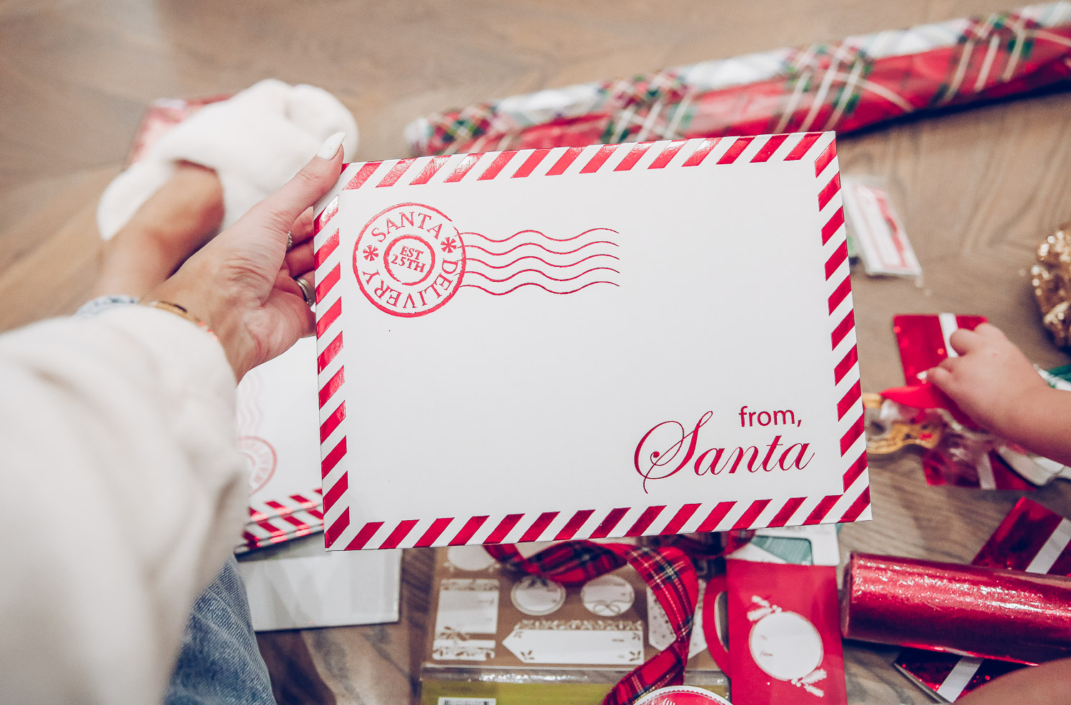 walmart gift wrap christmas 2020, shop hello holidays christmas tree, magnetic me PJs, emily ann gemma-10 |Gift Wrapping Ideas by popular US life and style blog, The Sweetest Thing: image of a woman holding a From Santa cardboard envelope.