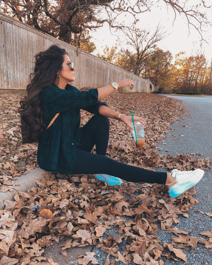 November Instagram Recap by popular US lifestyle blog, The Sweetest Thing: image of Emily Gemma sitting on a street curb and wearing a Superdown blue and green plaid shirt, black Zella leggings, Alexander McQueen sneakers, and Louis Vuitton backpack.