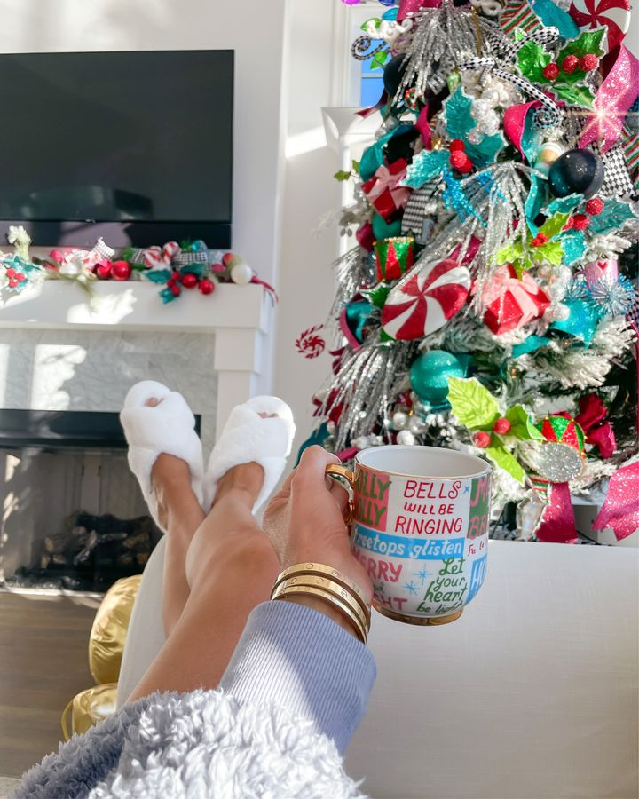November Instagram Recap by popular US lifestyle blog, The Sweetest Thing: image of Emily Gemma wearing a pair of white fuzzy BP. slippers and holding a Anthropologie Christmas mug.