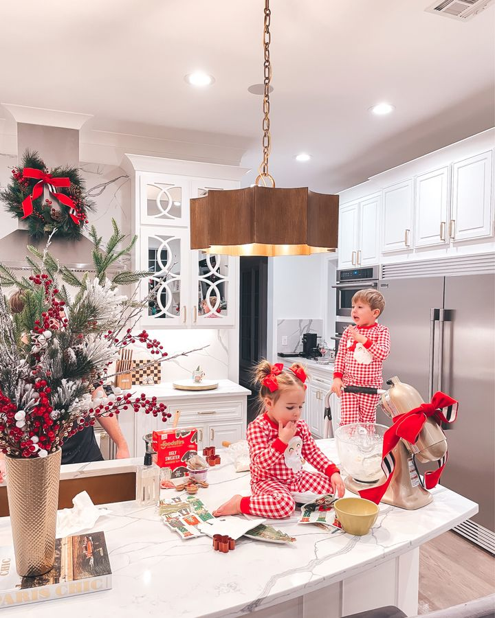 November Instagram Recap by popular US lifestyle blog, The Sweetest Thing: image of Emily Gemma's son and daughter wearing red and white plaid Santa pajamas and making cookies in their kitchen.