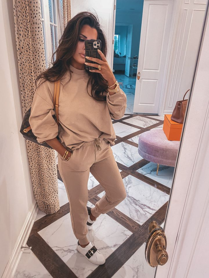 November Instagram Recap by popular US lifestyle blog, The Sweetest Thing: image of Emily Gemma wearing a Buddy Love sweatsuit, Fendi sneakers, and holding a phone in a Fendi case.