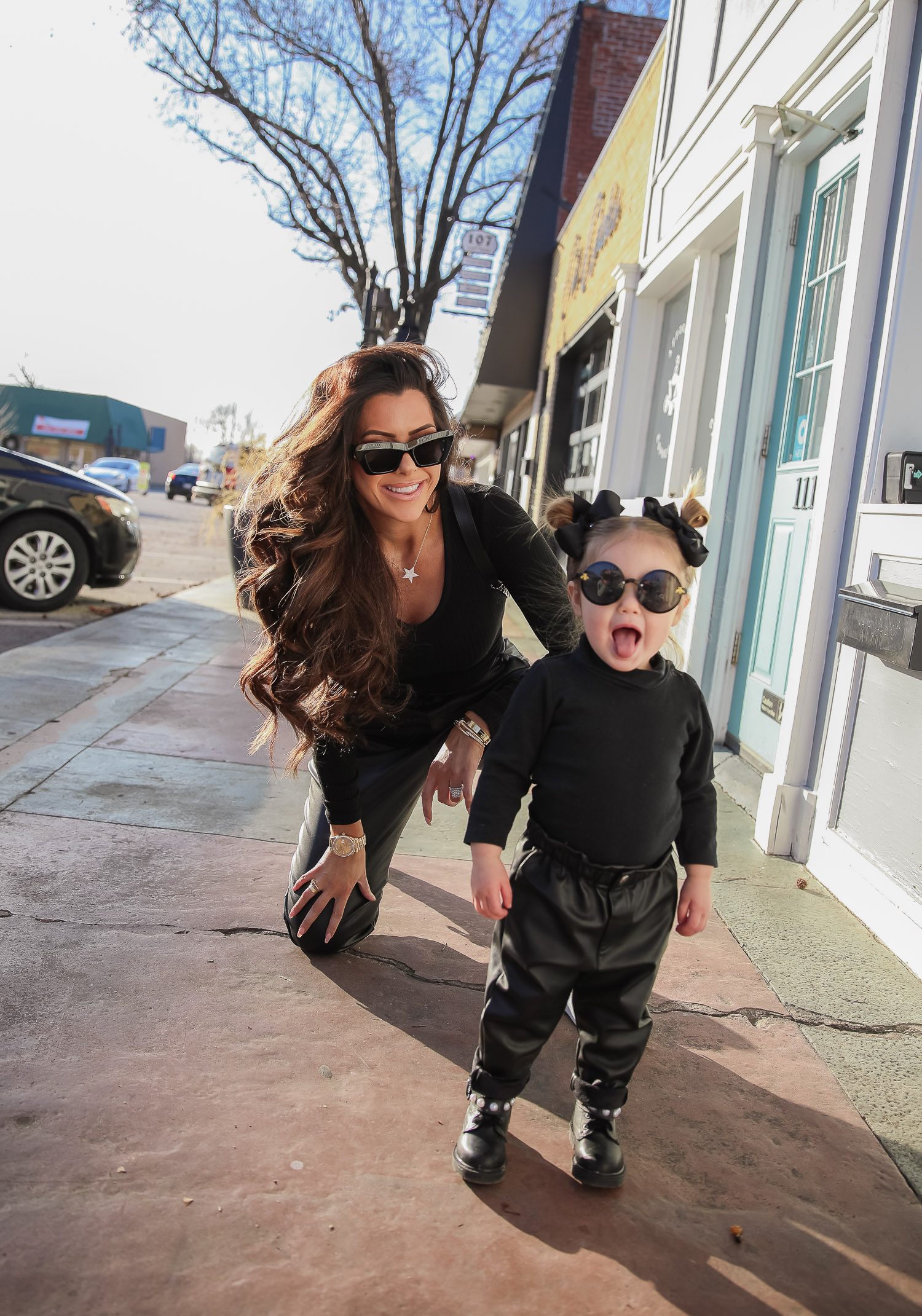 matching mommy daughter fashion outfits Pinterest, Emily Gemma, Nordstrom BP faux leather pants, loewe sunglasses, Alexander mcqueen sneakers gold white outfit pinterest |Mommy and Daughter by popular US fashion blog, The Sweetest Thing: image of a woman and her daughter walking together outside and wearing a pair of BP faux leather pants, Good American top, loewe sunglasses, Alexander mcqueen sneakers, Monica Vinader ring, Nadri bracelet, Nadri earrings, and Rolex watch.