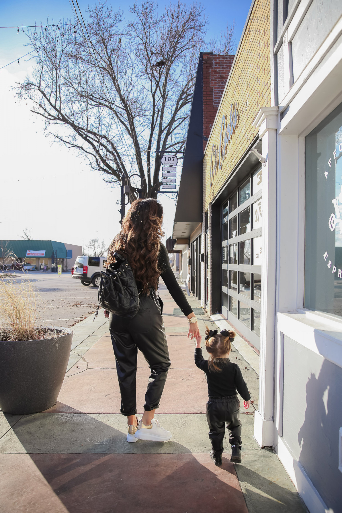 matching mommy daughter fashion outfits Pinterest, Emily Gemma, Nordstrom BP faux leather pants, loewe sunglasses, Alexander mcqueen sneakers gold white outfit pinterest  Mommy and Daughter by popular US fashion blog, The Sweetest Thing: image of a woman and her daughter walking together outside and wearing a pair of BP faux leather pants, Good American top, loewe sunglasses, Alexander mcqueen sneakers, Monica Vinader ring, Nadri bracelet, Nadri earrings, and Rolex watch.