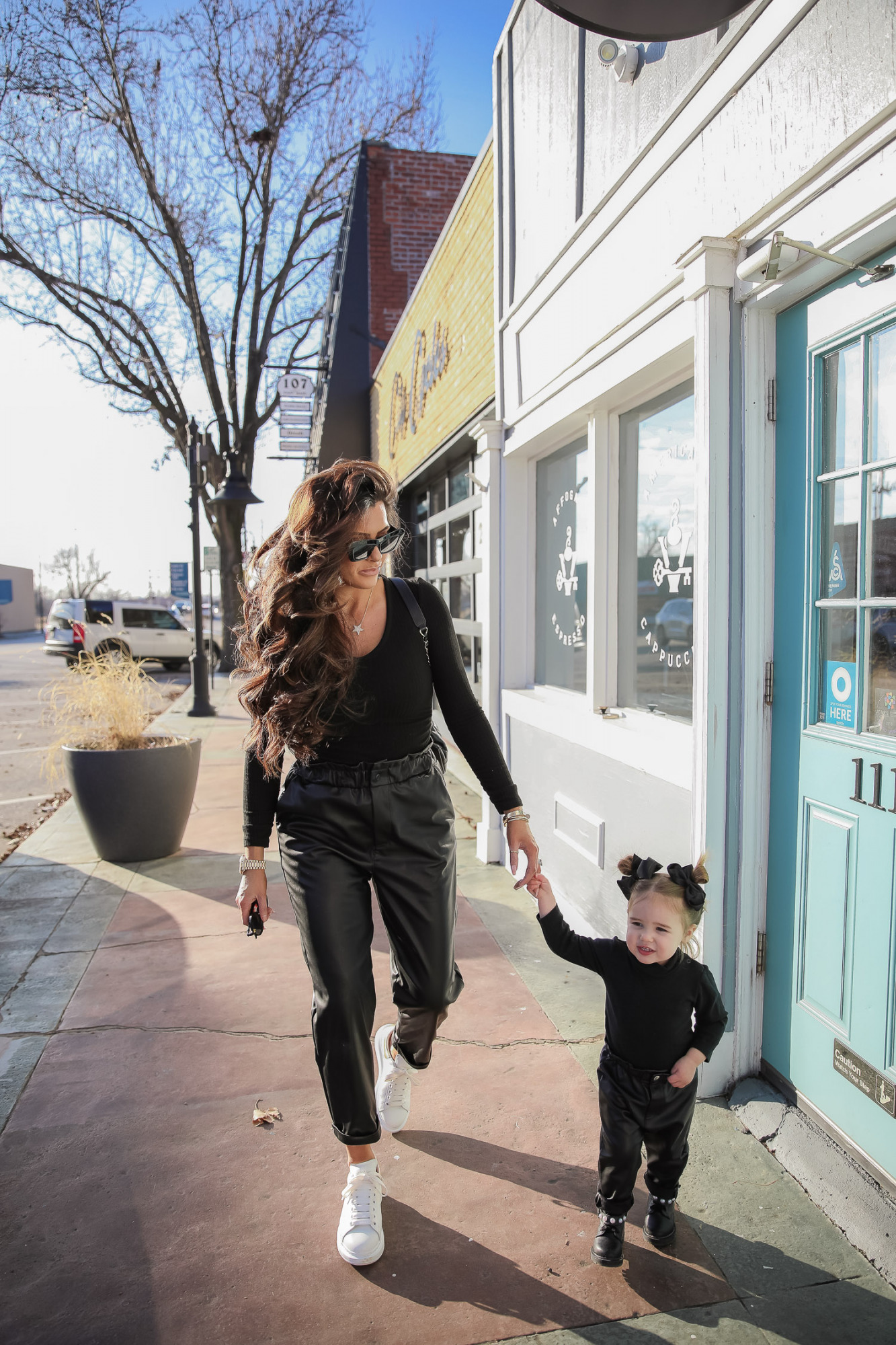 matching mommy daughter fashion outfits Pinterest, Emily Gemma, Nordstrom BP faux leather pants, loewe sunglasses, Alexander mcqueen sneakers gold white outfit pinterest | Mommy and Daughter by popular US fashion blog, The Sweetest Thing: image of a woman and her daughter walking together outside and wearing a pair of BP faux leather pants, Good American top, loewe sunglasses, Alexander mcqueen sneakers, Monica Vinader ring, Nadri bracelet, Nadri earrings, and Rolex watch.