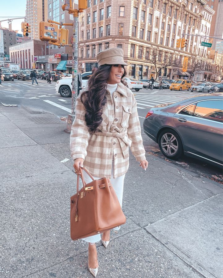 shacket, gold christian louboutin pumps, christian dior cap, Hermes birkin, white denim, turtleneck sweater, New York city outfit ideas, Emily gemma