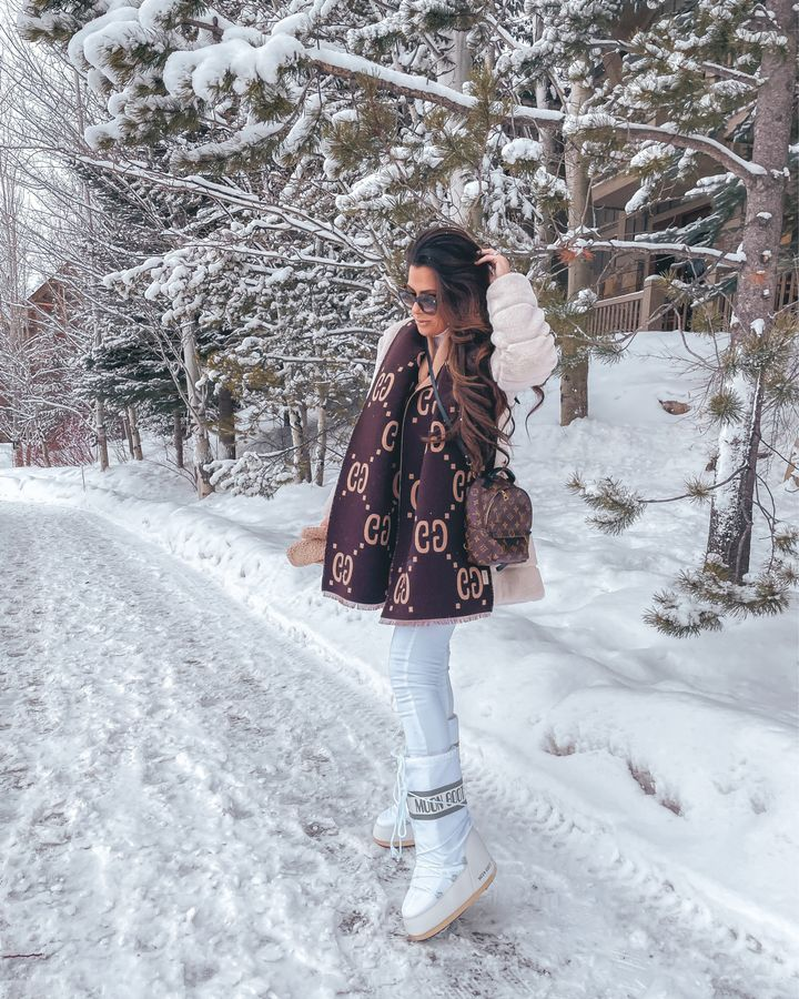 Emily gemma, winter outfit ideas, gucci scarf, how to style moon boots, faux fur coat, white denim, what to wear in the snow, Louis Vuitton Monogram Palm Springs Backpack Mini