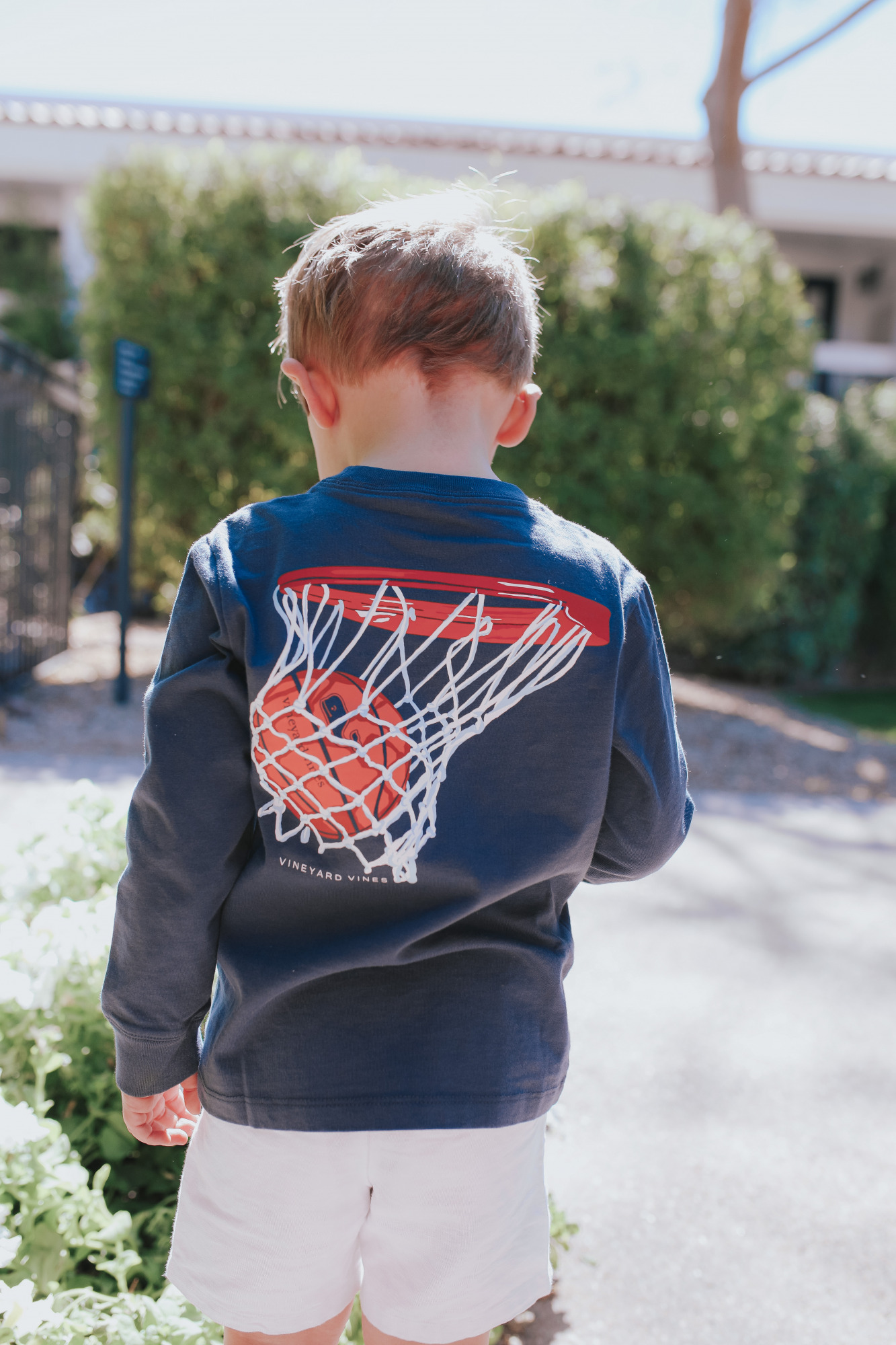 emily gemma, nordstrom vineyard vines tee shirt kids, scottsdale fashion blogger |Mom Jeans by popular US fashion blog, The Sweetest Thing: image of a little boy standing outside in Scottsdale, Arizona and wearing a Vineyard Vines t-shirt with tan shorts.