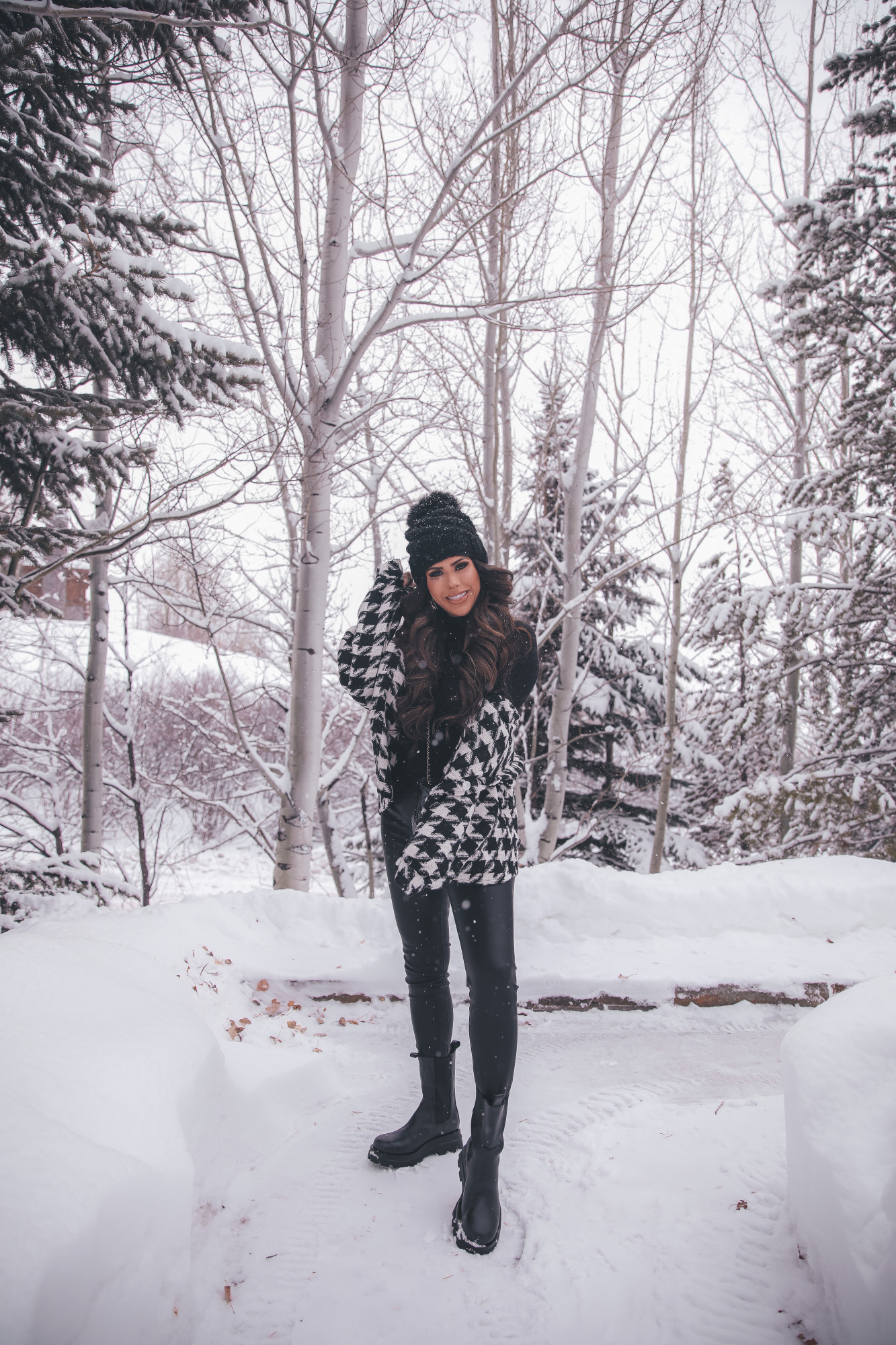 houndstooth shacket storets, lug sole black boot outfit ideas pinterest, jackson hole, winter fashion outfits |Lug Sole Boots by popular US fashion blog, The Sweetest Thing: image of Emily Gemma wearing a Storets black and white houndstooth jacket, Good American bodysuit, BlankNYC faux leather pants, Steve Madden black lug sole boots, BP. sunglasses, TopShop black pom beanie, Chanel handbag, Monica Vinader ring, Rolex watch, Cartier bracelets, and Iconic Nude' + KIM K.W. + White Russian Sparkle lip combo.