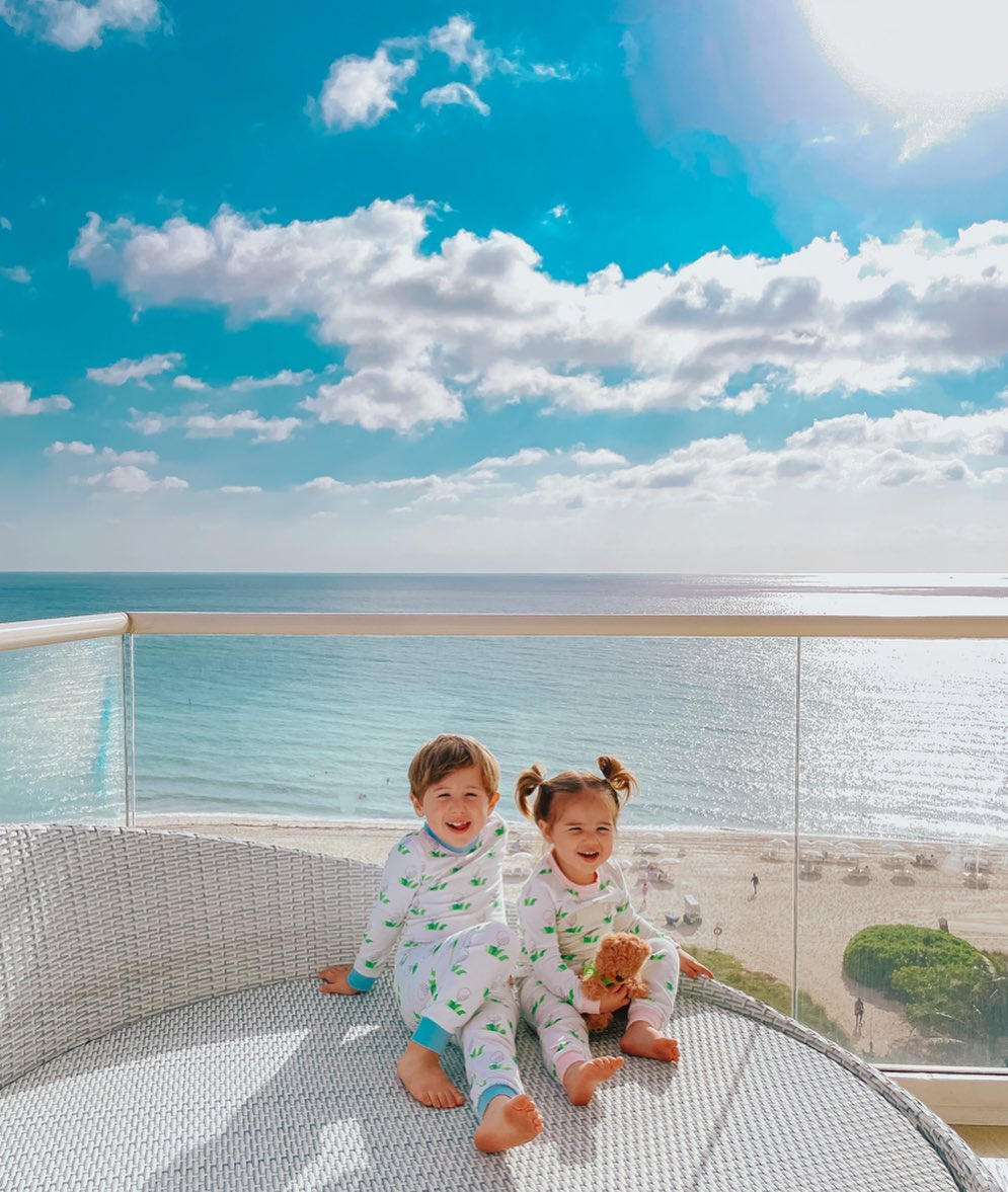 little girls pajamas, toddler pajamas, Little boys pajamas, The Gemma Gang, Golf Pajamas, Smocked Auctions, Sleepwear for kids |Instagram Recap by popular US fashion blog, The Sweetest Thing: image of two kids sitting outside on a balcony and wearing matching Smocked Auctions pajamas.