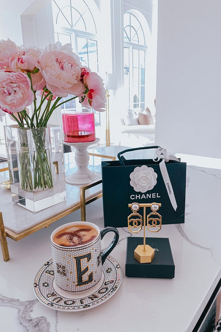 Kitchen Decor, Peonies, Glass Vase, Chanel Earrings, Emily Gemma, Latte Art, Gold Marble Tray, Emily Gemma Home |Instagram Recap by popular US fashion blog, The Sweetest Thing: image of a Chanel shopping bag, Chanel earrings on a gold earring stand, Monogram Anthropologie mug, and clear glass vase filled with pink peonies.