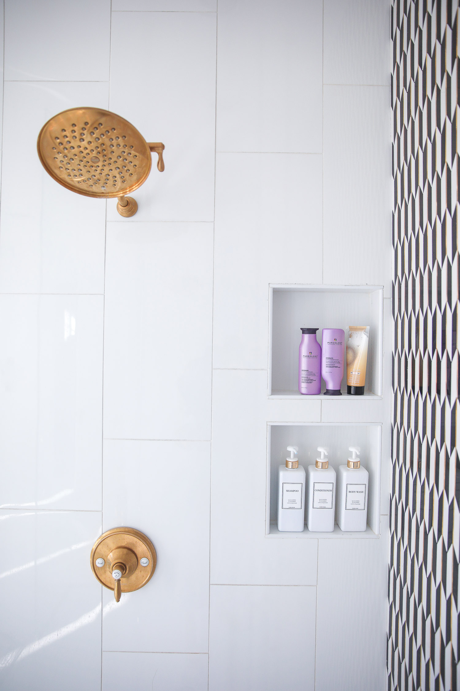 hair dot com, best hair products for long hair and extensions, Purology shampoo and conditioner, emily gemma, the sweetest thing blog |Hair Products by popular US beauty blog, The Sweetest Thing: image of a walk-in shower stocked with Pureology and Dae hair products.