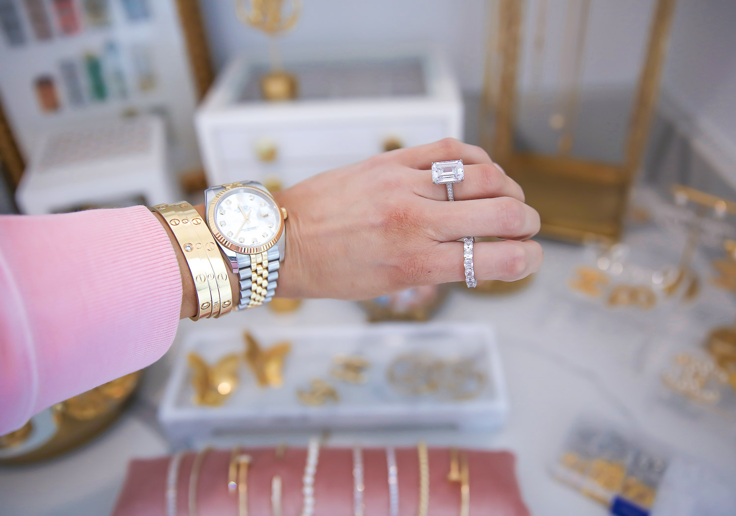 Amazon must haves blog posts, amazon jewelry engagement rings, Rolex date just, Emily Gemma amazon, |Amazon Must Haves by popular US life and style blog, The Sweetest Thing: image of Emily Gemma wearing a Rolex watch, Emerald cushion cut ring, and emerald cut eternity band.
