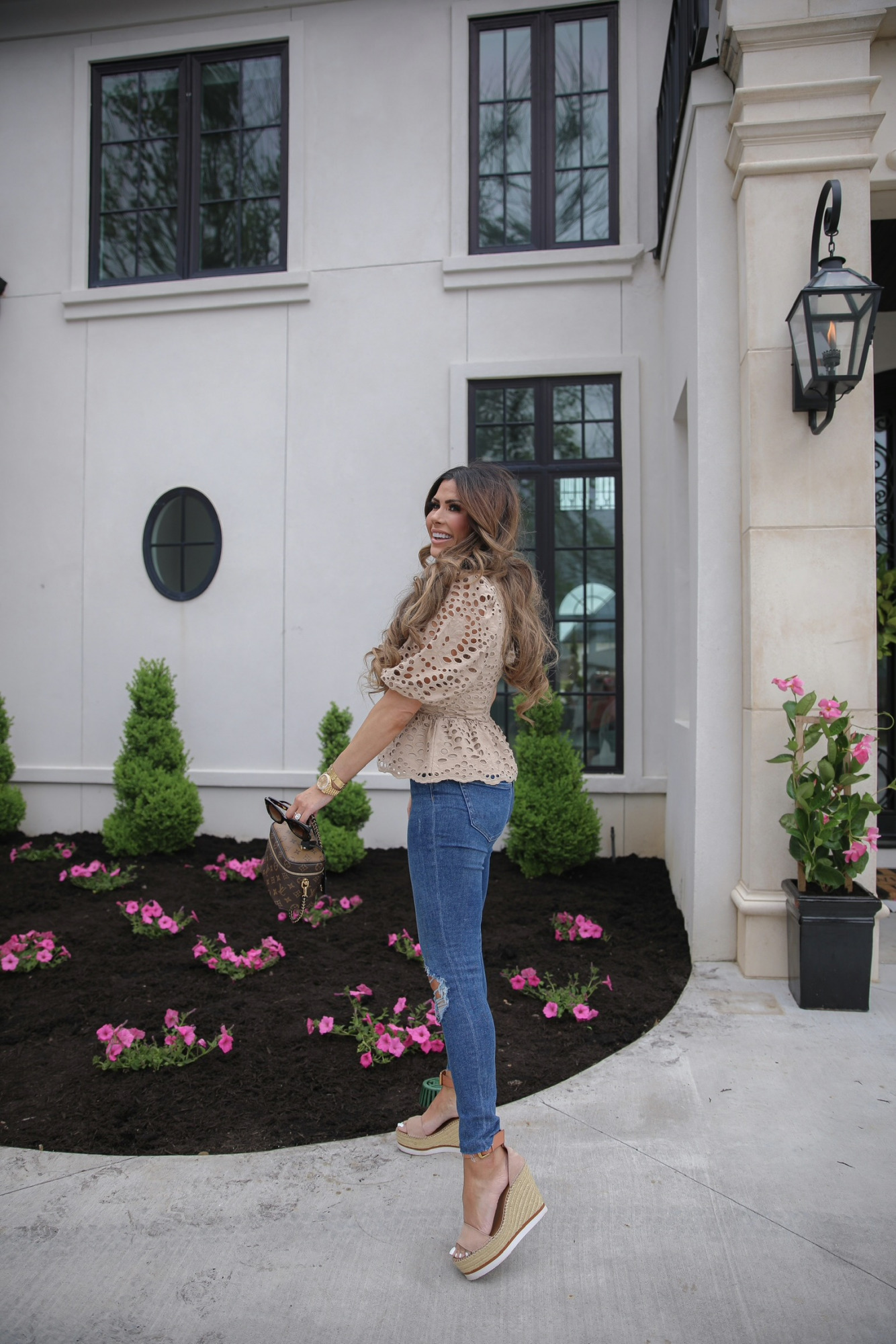 Express Spring 2021, Casual Outfit, Best Denim Spring 2021, Affordable Denim, Lace Top, Emily Ann Gemma |Spring Fashion by popular US fashion blog, The Sweetest Thing: image of Emily Gemma wearing an Express Eyelet Lace Puff Sleeve Ruffle Peplum Top, Express jeans, and Chloe wedge sandals while holding a Louis Vuitton bag.