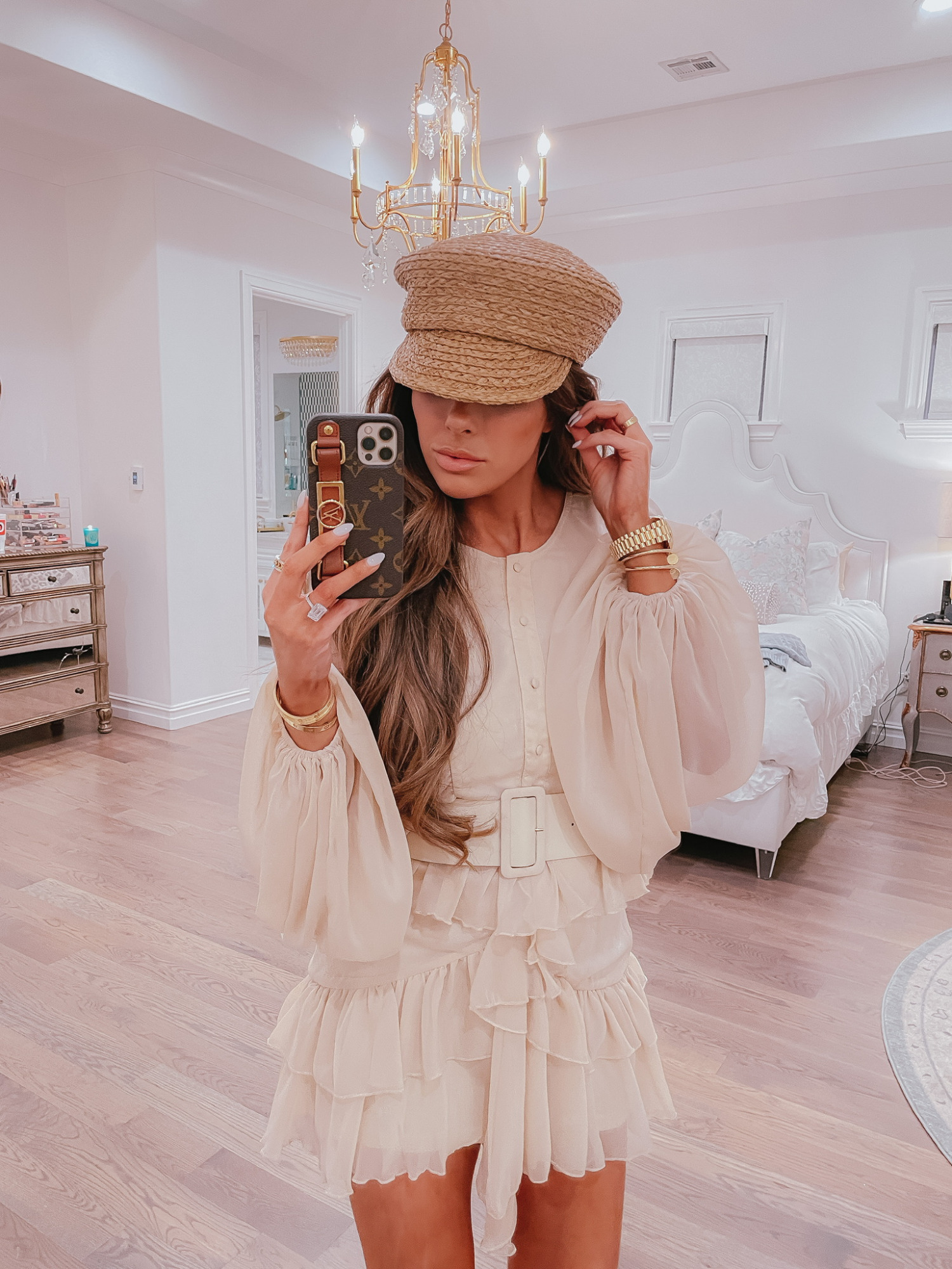 Ruffle Dress, Spring Dress, Cream Dress, Long Sleeved Mini Dress, Belted Dress, Vici Collection, Try-On Haul, Emily Ann Gemma  VICI Fashion by popular US fashion blog, The Sweetest Thing: image of Emily Gemma wearing a VICI tan tiered ruffle skirt belted dress with a straw hat.