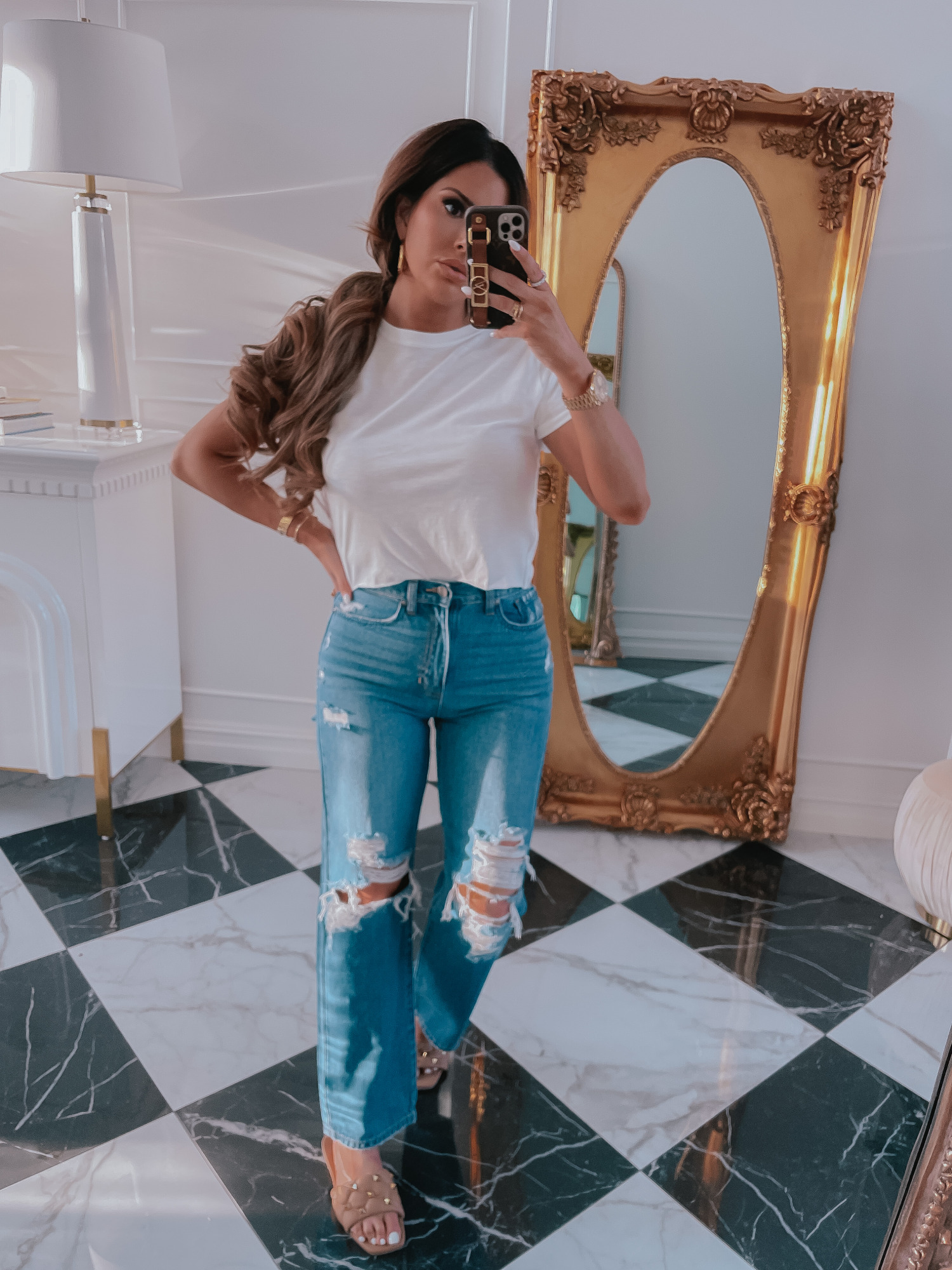 Best Basic White T-Shirt, Ripped Jeans, Spring Outfit Ideas 2021, Nude Sandals, Emily Ann Gemma, Best Closet Basics Spring 2021 |Spring Fashion by popular US fashion blog, The Sweetest Thing: image of Emily Gemma wearing a white t-shirt, distressed denim and tan studded slide sandals.