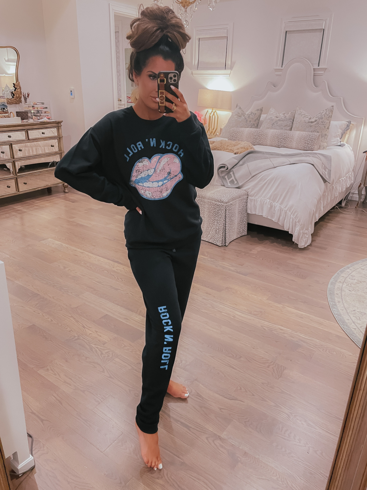 Vici Try On by popular US fashion blog, The Sweetest Thing: image of Emily Gemma wearing a Vici rock and sweatshirt and sweat pants set.