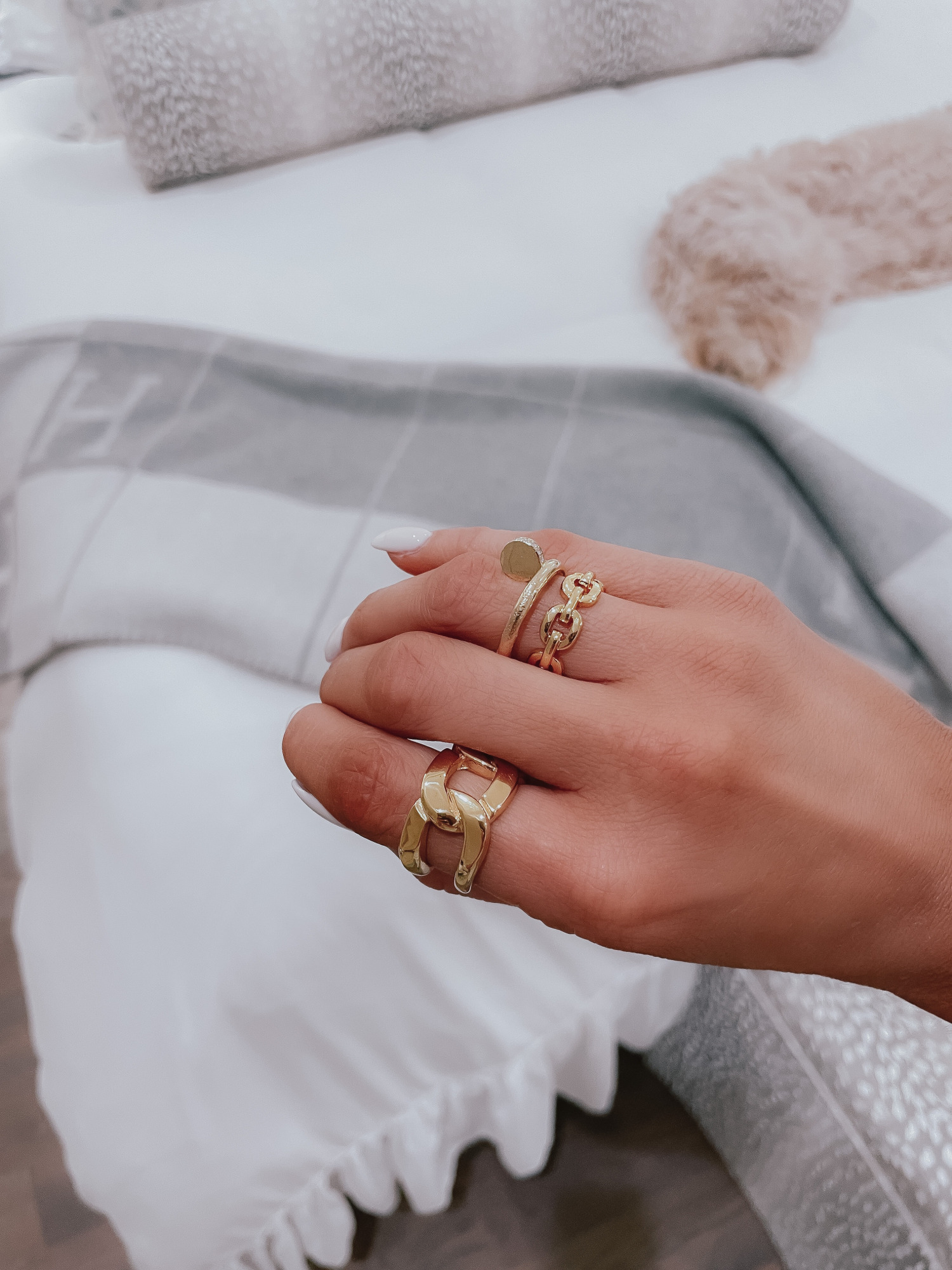 Vici Try On by popular US fashion blog, The Sweetest Thing: image of Emily Gemma wearing a oversized gold chain ring and a medium size gold chain ring.