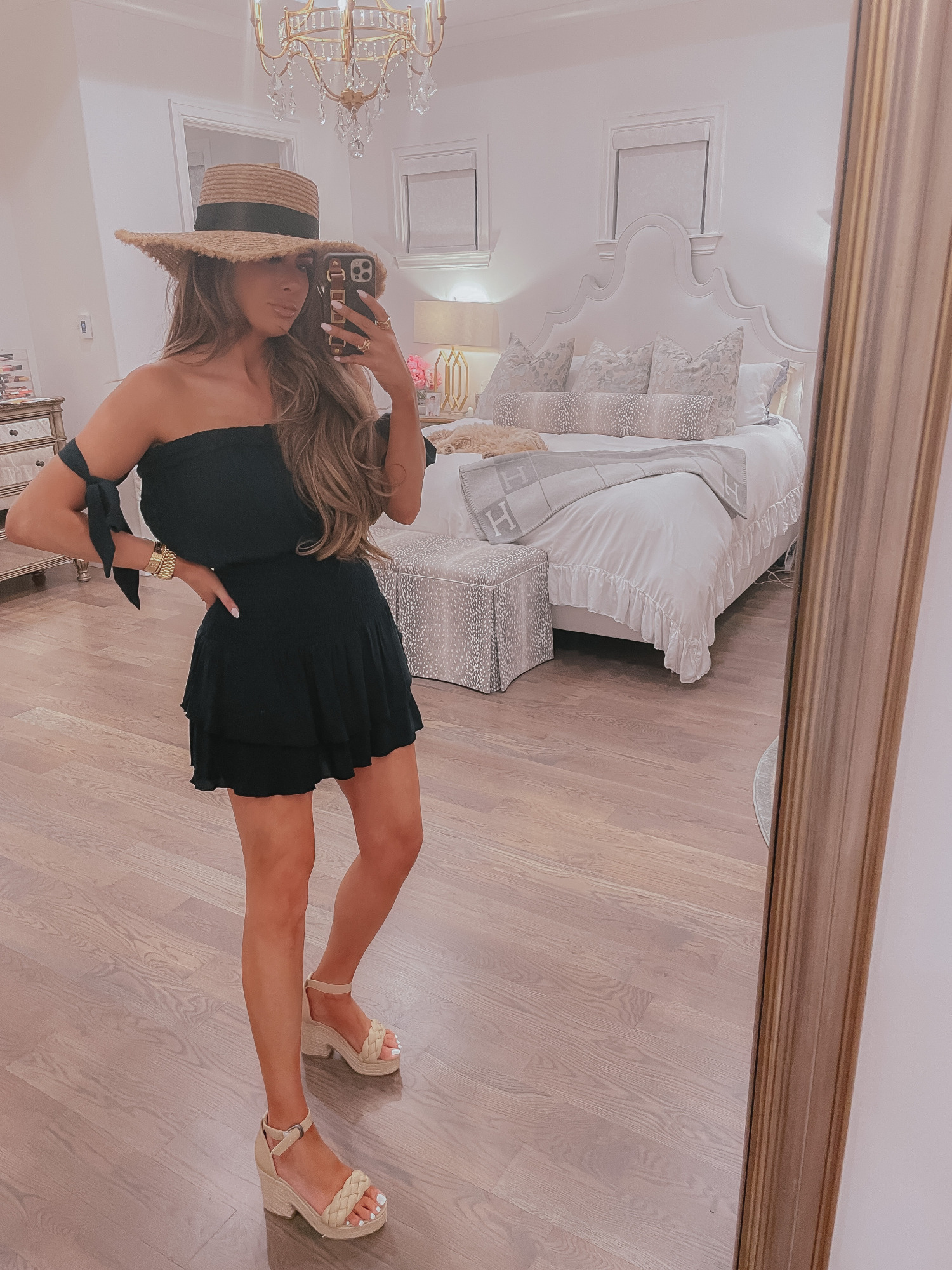 Vici Try On by popular US fashion blog, The Sweetest Thing: image of Emily Gemma wearing a black strapless Vici dress, straw sun hat, and nude block heel sandal.