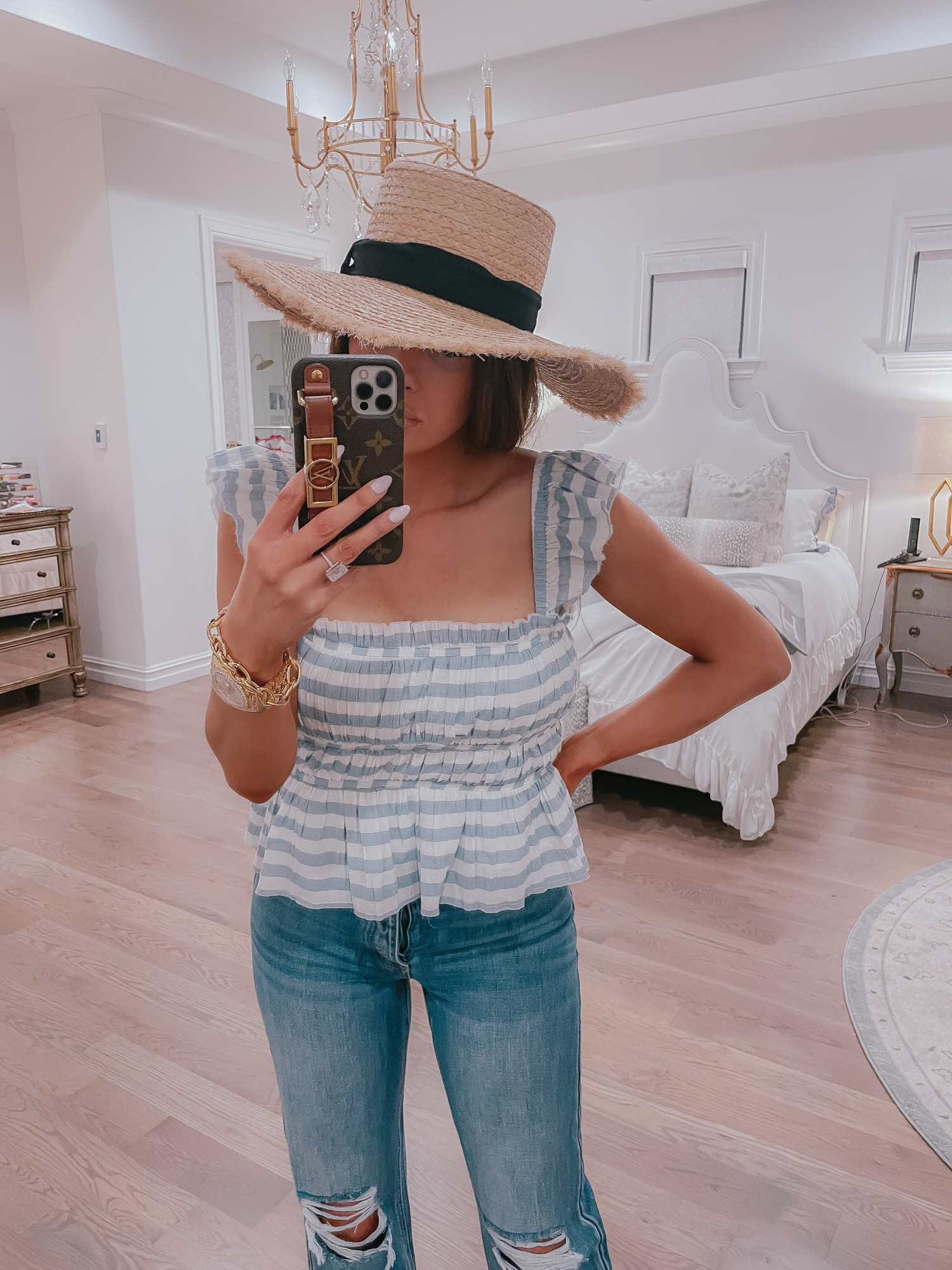 Vici Try On by popular US fashion blog, The Sweetest Thing: image of Emily Gemma wearing a Vici blue and white stripe peplum top, straw hat, and deconstructed jeans.