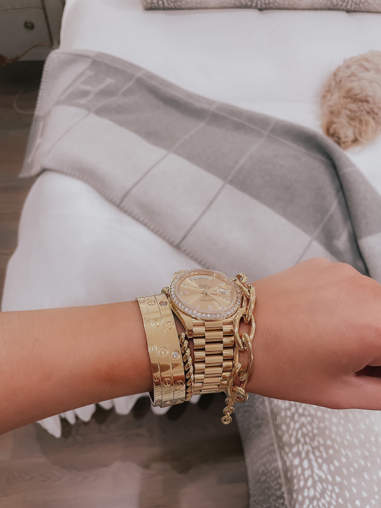 Vici Try On by popular US fashion blog, The Sweetest Thing: image of Emily Gemma wearing gold Cartier bracelets and a gold Rolex watch.